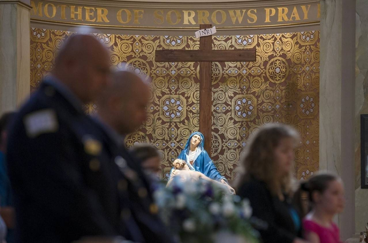 Mourners attend the funeral mass for an abandoned newborn baby boy at St. Hyacinth Basilica in Chicago.
