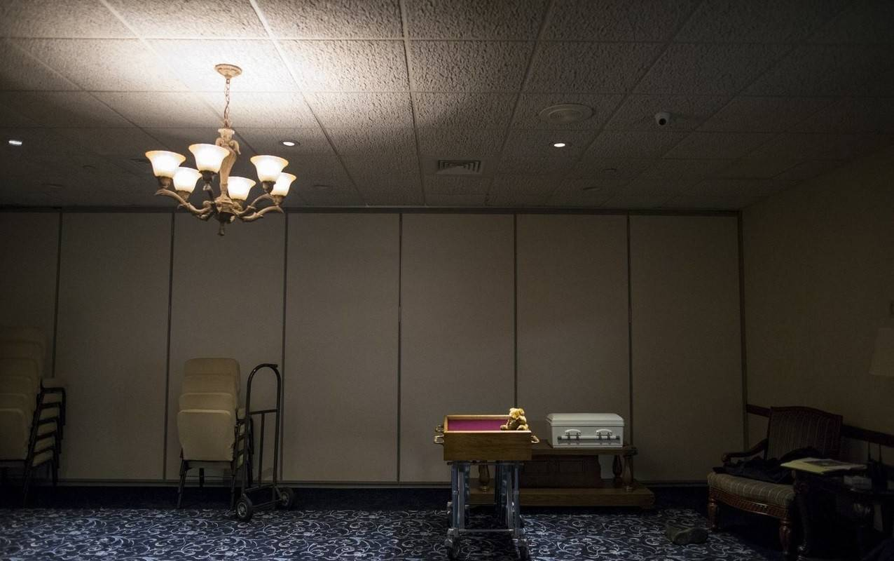 A casket containing the remains of an abandoned newborn baby is seen in a chapel at Glueckert Funeral Home in Arlington Heights in preparation for funeral and burial services.