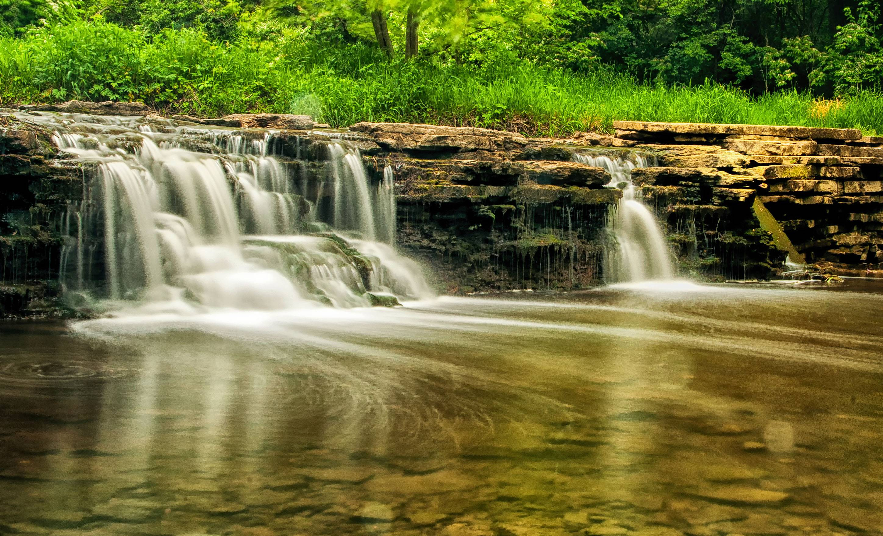 This photo is of the waterfall at Water Fall Glen Forest Preserve. A very pretty fall hidden back on the trail in the preserve. I used a neutral density filter and time exposure to get this ethereal view.