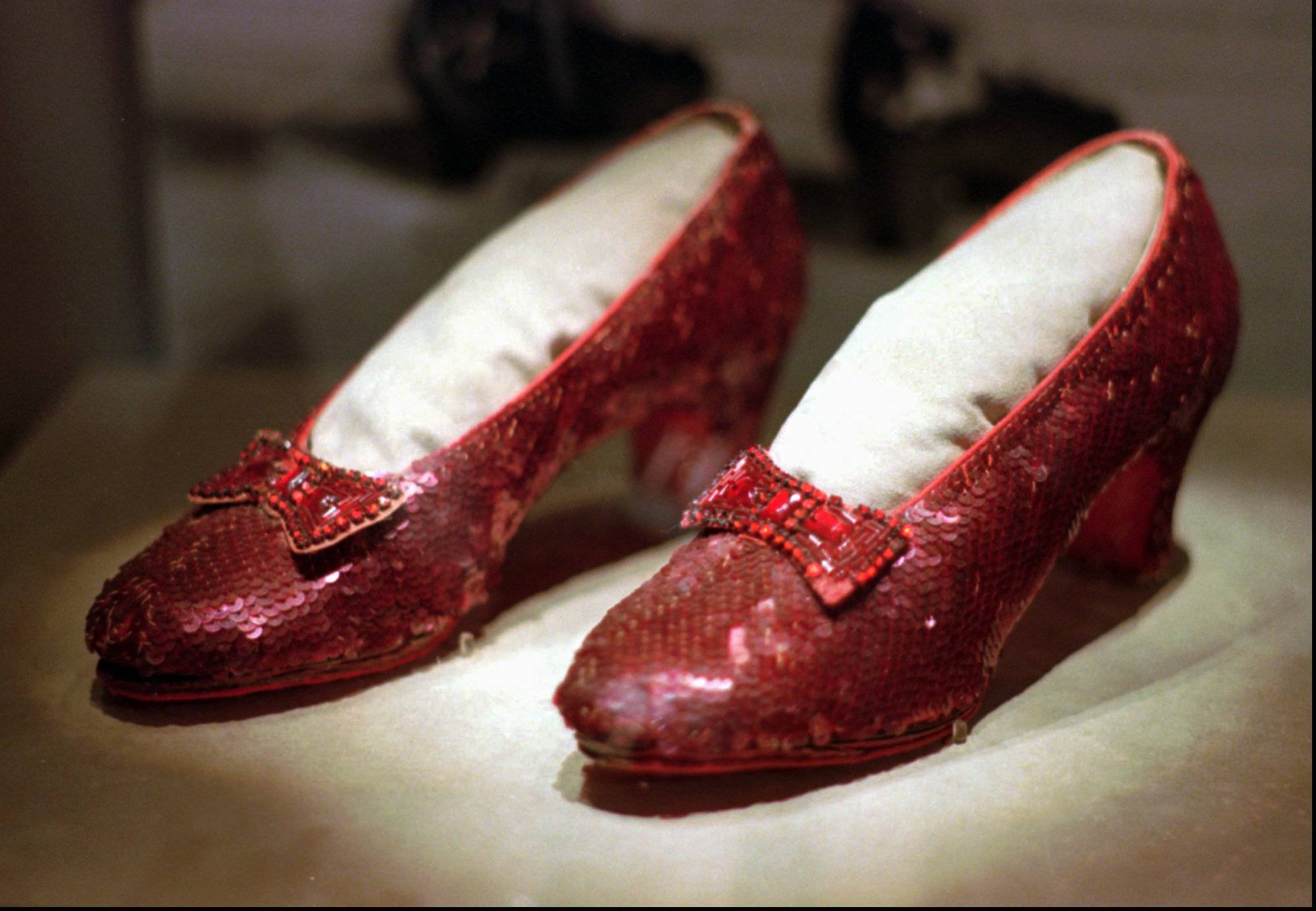 "One of the four pairs of ruby slippers worn by Judy Garland in the 1939 film ""The Wizard of Oz"" on display during a media tour of the ""America's Smithsonian"" traveling exhibition in Kansas City, Mo. An anonymous donor has offered a $1 million reward for credible information leading to a pair of the sequined shoes which was stolen from a museum in her Minnesota hometown, Grand Rapids. The 10-year anniversary of the theft is in August 2015."