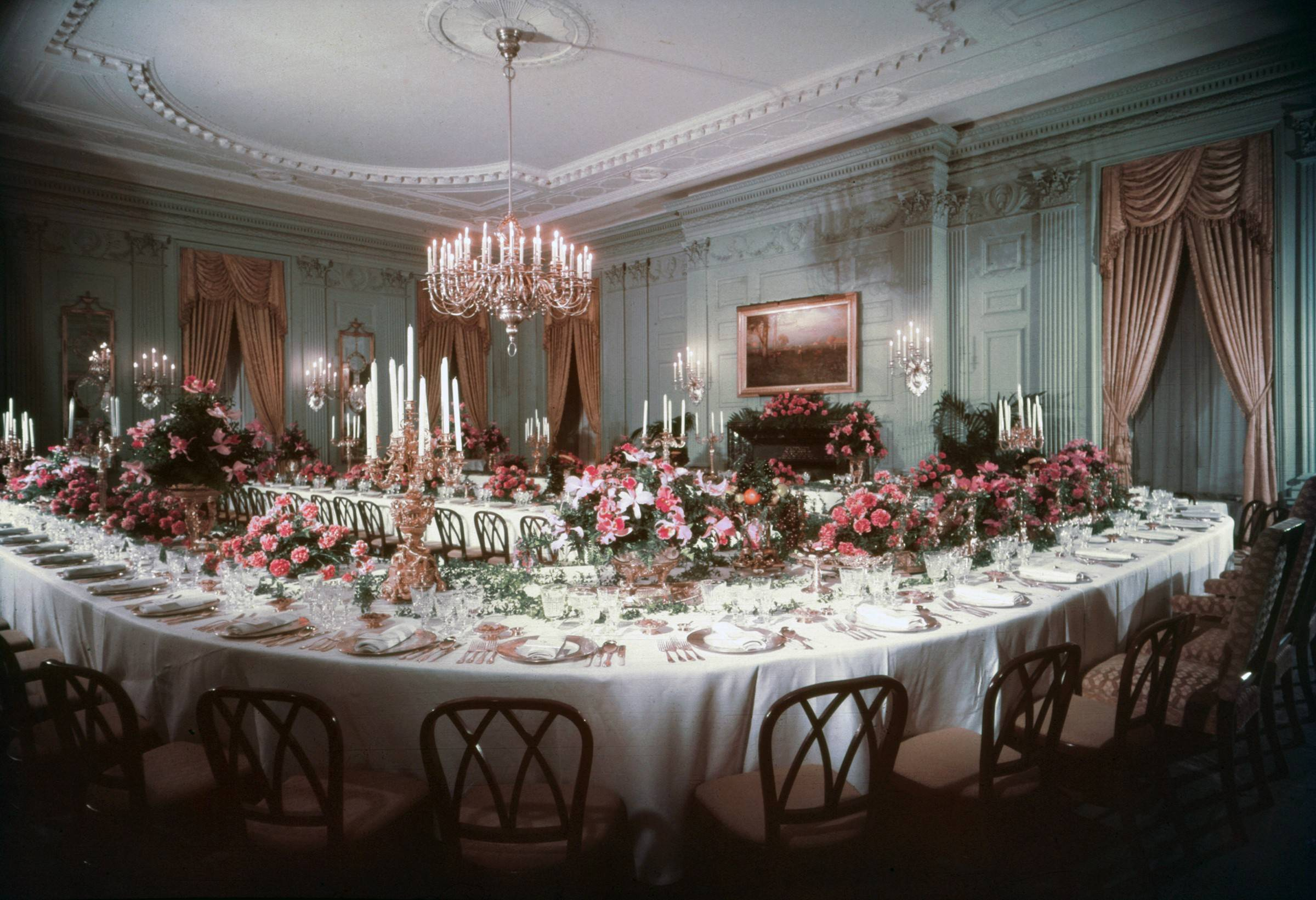 The White House's State Dining Room as it appeared in 1960 after the Truman renovation. The room is set up for a dinner with the king and queen of Denmark.