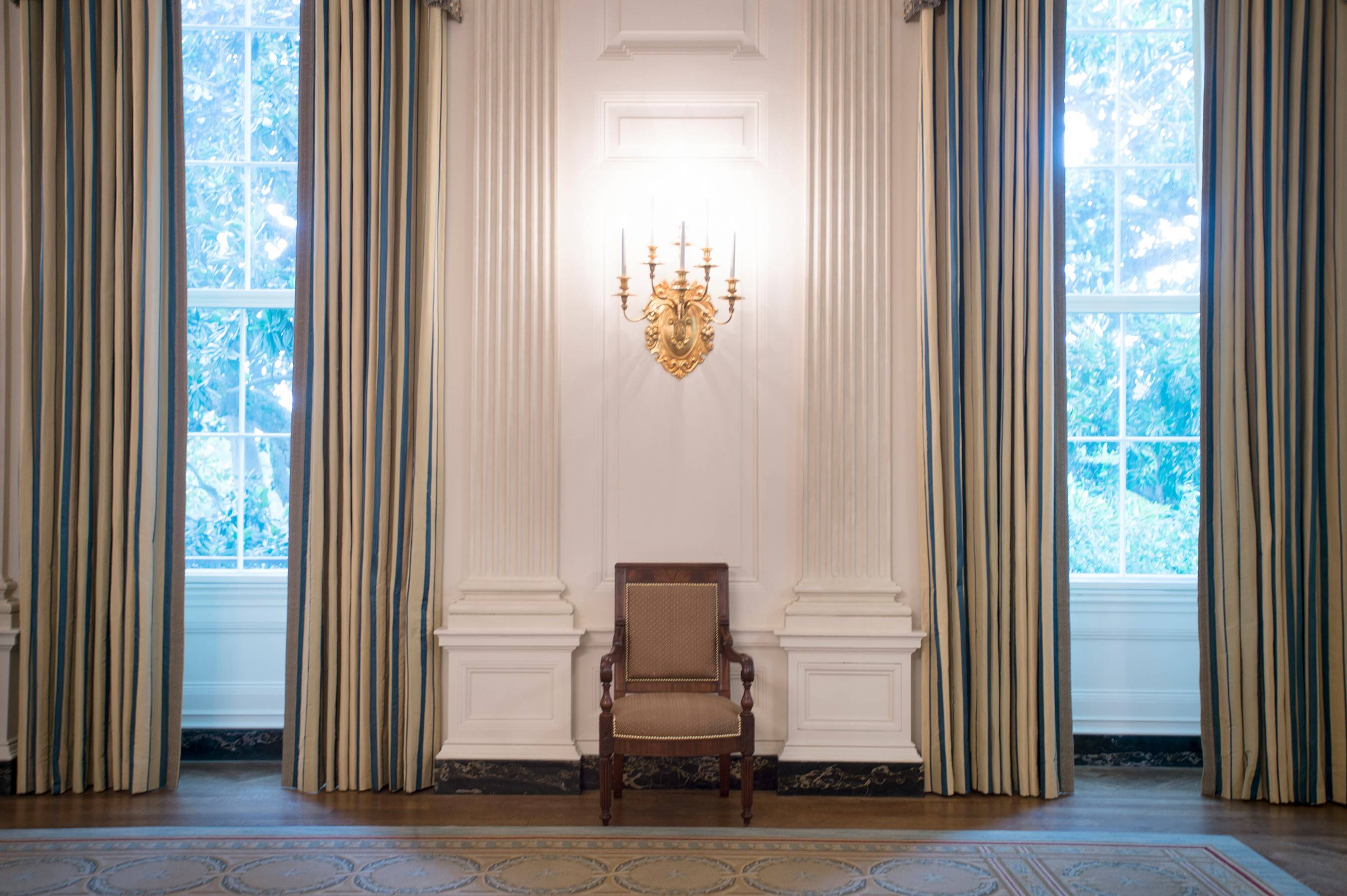 The makeover of the White House State Dining Room dressed up the space with sumptuous new silk curtains, a set of 34 new mahogany chairs inspired by ones from the Monroe era and a new paint job that highlights the architecture in the room.