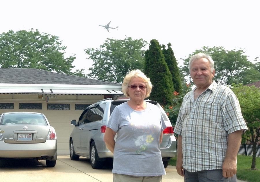 Jolanta Gorniak and husband, Chester, can't get used to the din of planes over their heads on Hillside Drive in Bensenville.