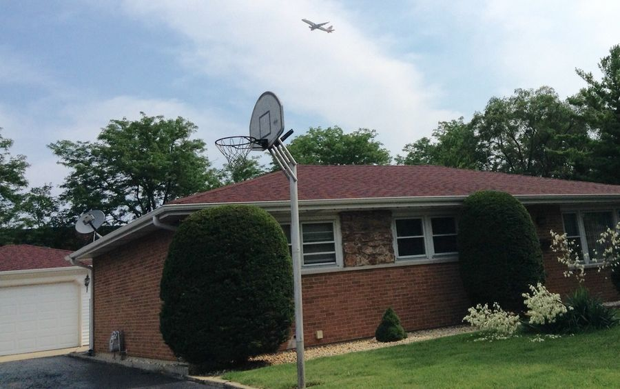 Jets are a constant presence on Hillside Drive in Bensenville. Residents say landings are even louder than departures from O'Hare International Airport.