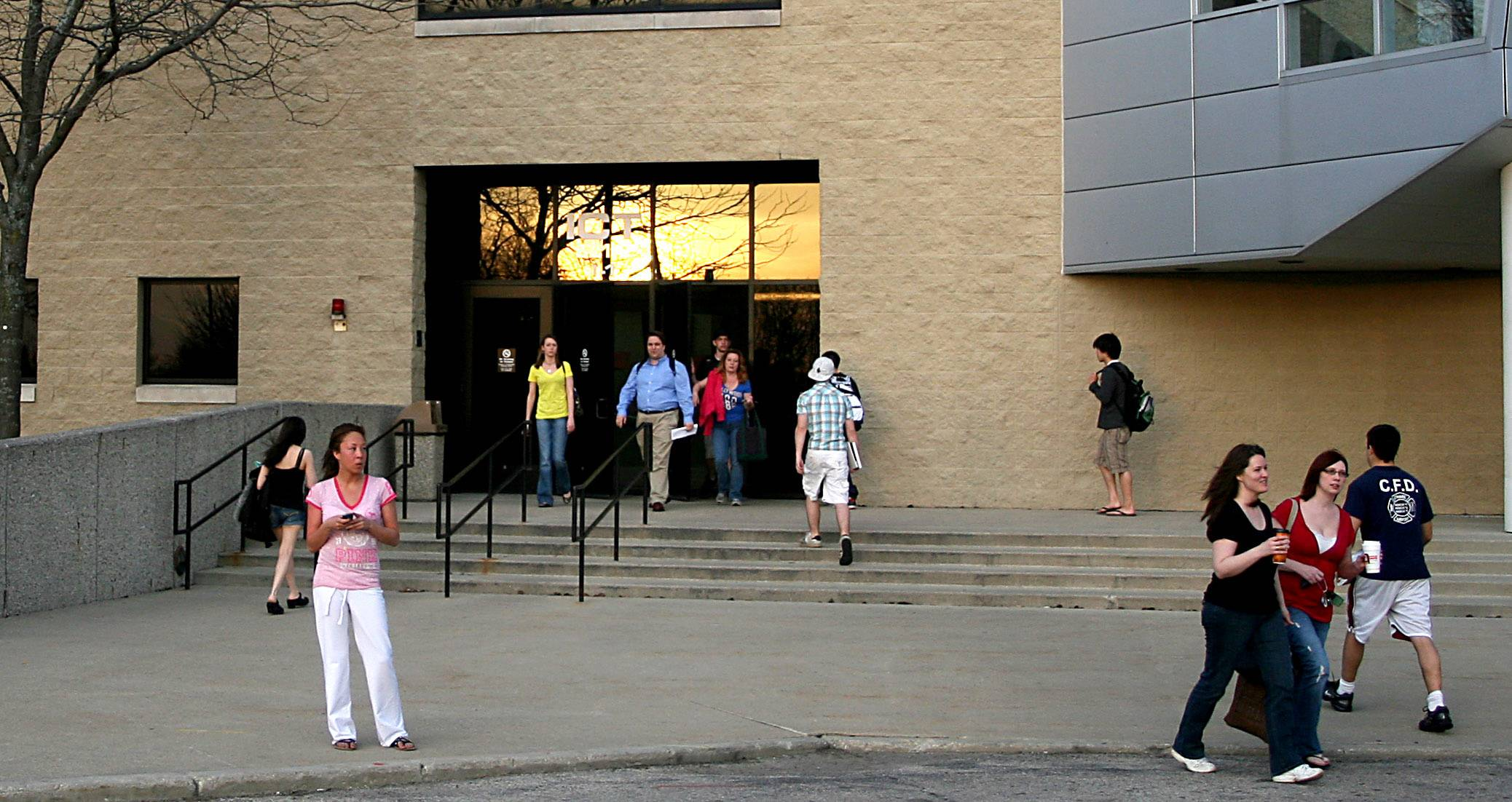 Students and visitors move about outside the ICT building on the campus of Elgin Community College last week.