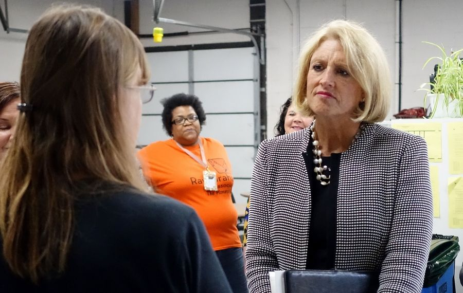 Illinois Comptroller Leslie Munger, right, talks to instructor Anita Callahan Friday at the Ray Graham Association's Larry J. Bell Community Learning Center in Lisle.