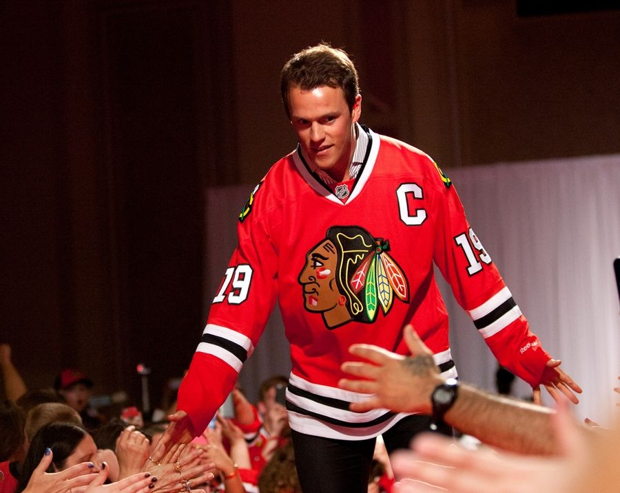 Jonathan Toews greets fans during the 8th annual Blackhawks Convention at the Hilton Chicago on Friday. Toews says he isn't sure how the new team will gel, but they'll still try to go out and win every day.