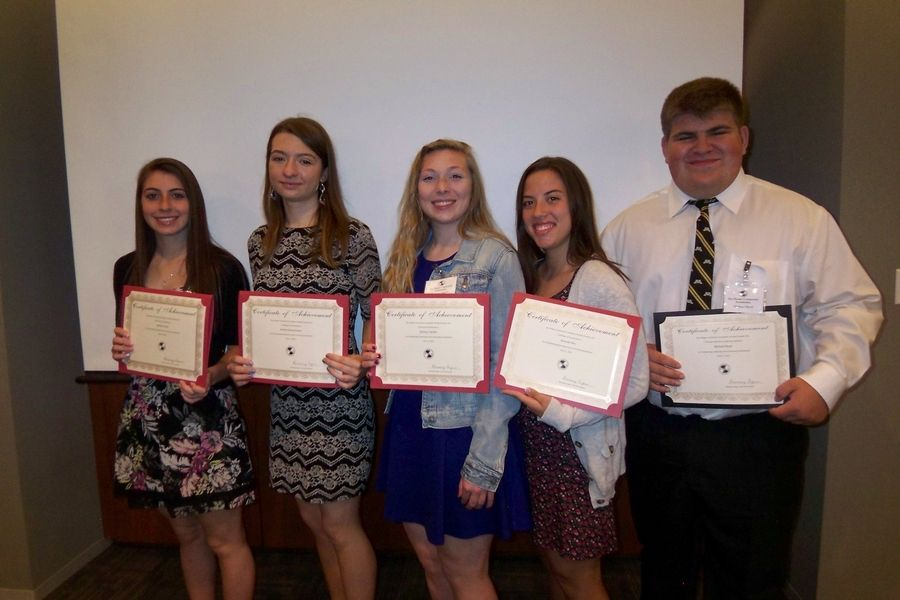 Scholarship recipients, from left, are: Melissa Picchi, Elk Grove High School; Anetta Siemanowicz, Maine East High School; and Mallory Tamillo, Amanda Rey and Michael Boyd of Maine West High School. Boyd is the first recipient of the Sadie Rose Argus Leadership Award.