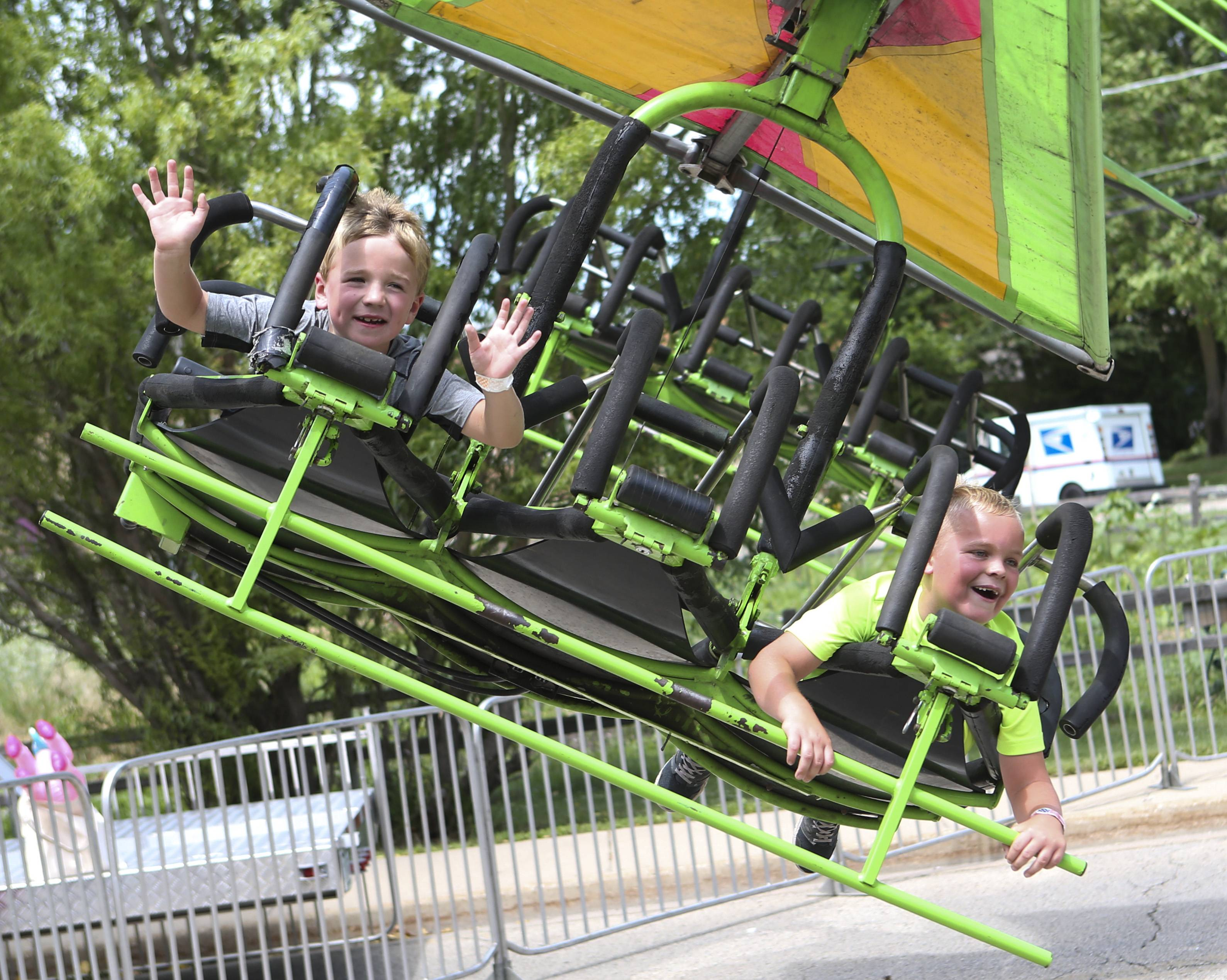 Emery Ipsen, 6, of Antioch and Owen Shea, 7, of Antioch smile while riding a ride during the Antioch Taste of Summer Carnival on Saturday, July 18, in Antioch.