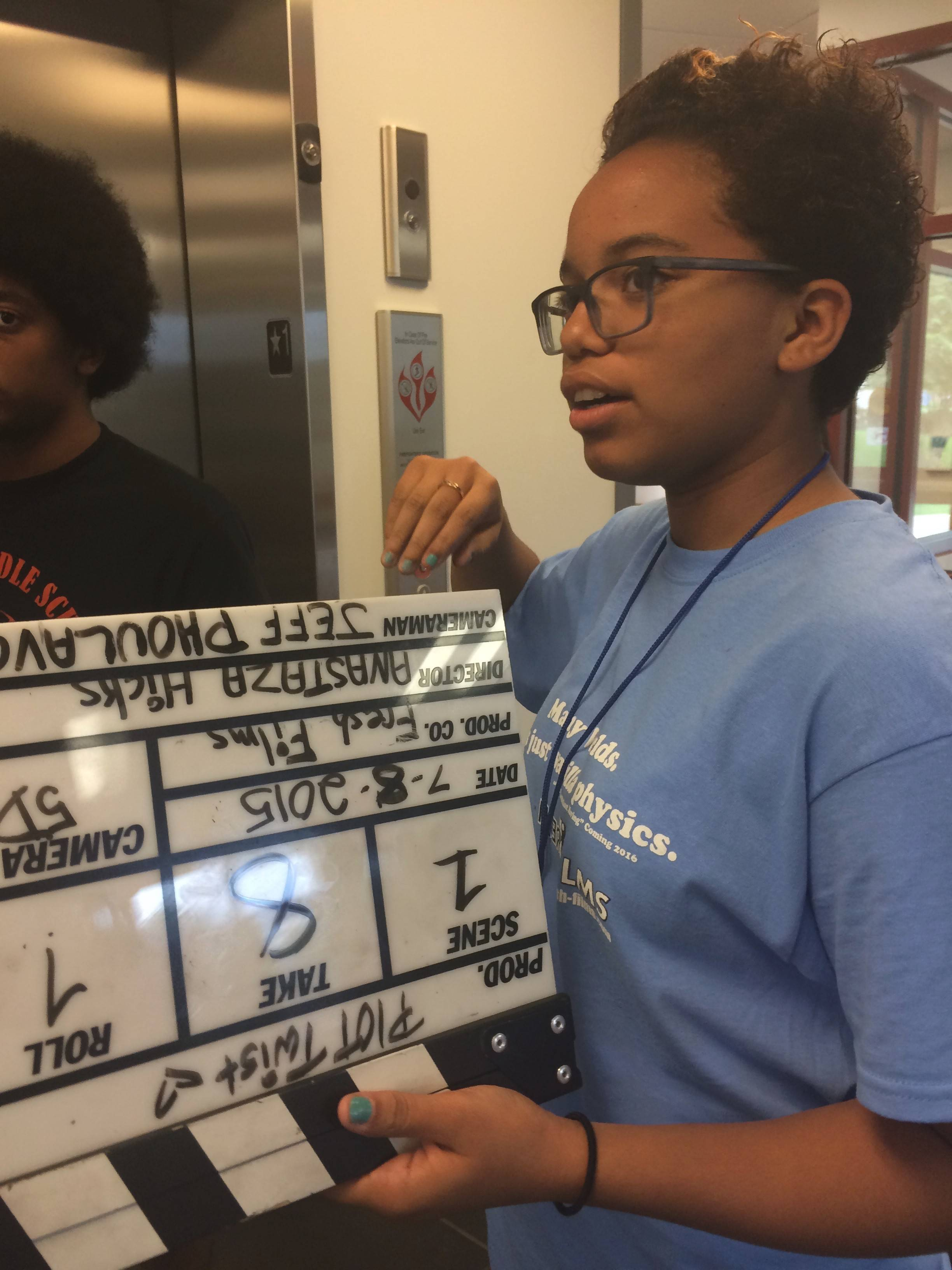 "Ahree Velasquez of the Boys and Girls Club of Elgin works behind the scenes at the movie shoot for Fresh Films' ""Traveling Without Moving."""