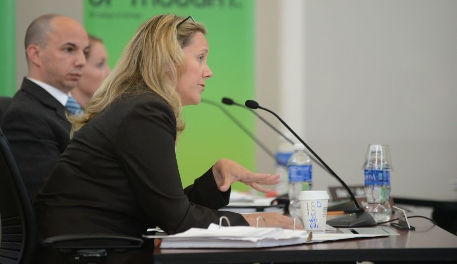 Deanne Mazzochi of the College of DuPage board of trustees answers questions Tuesday from the Higher Learning Commission about whether the school meets all the criteria to receive accreditation from the agency.