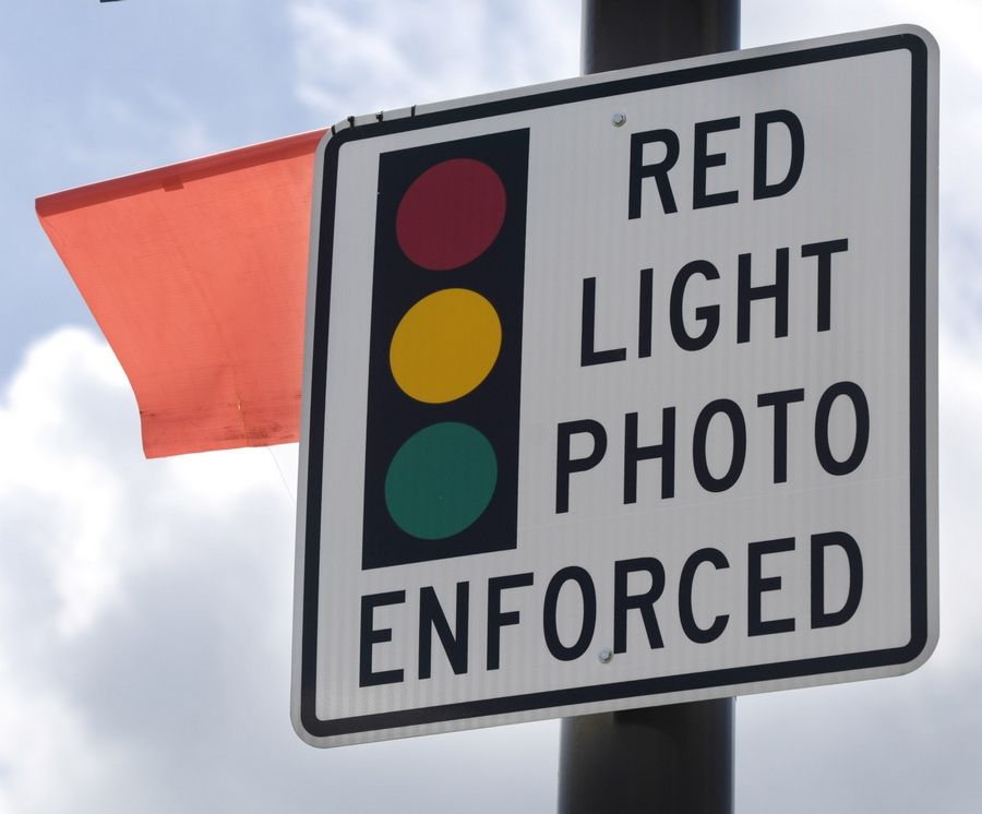 Attorneys are arguing that a state law allowing red-light cameras in the suburbs is unconstitutional.