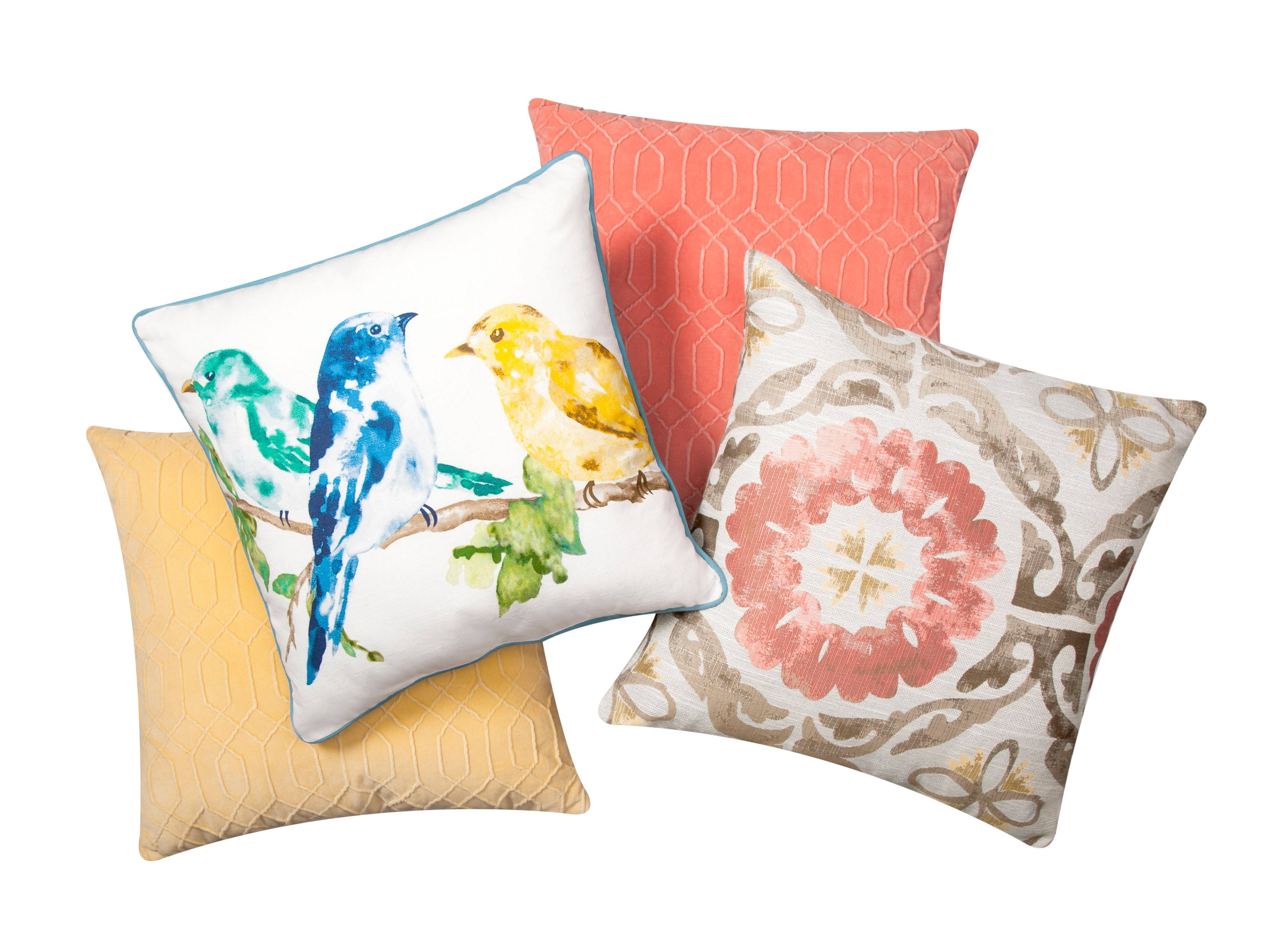 Mix standard items such as understated pillows with attention-grabbing pieces to achieve a wild, yet cohesive look.