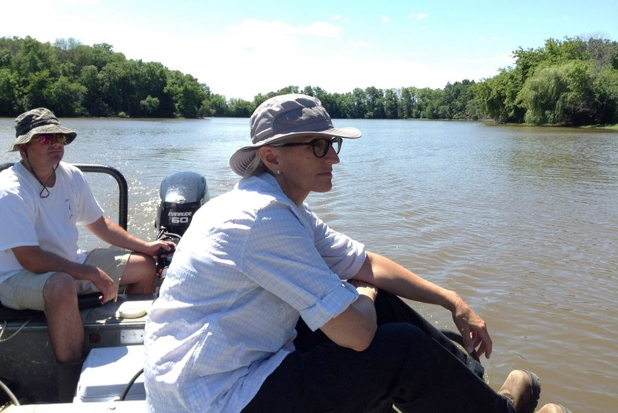 Leslie Berns, manager of landscape ecology for the Lake County Forest Preserve District, is overseeing a project to drain Rasmussen Lake at Ethel's Wood Forest Preserve near Antioch. Andy Plauck, a district fisheries biologist for the Illinois Department of Natural Resources, operates the boat.