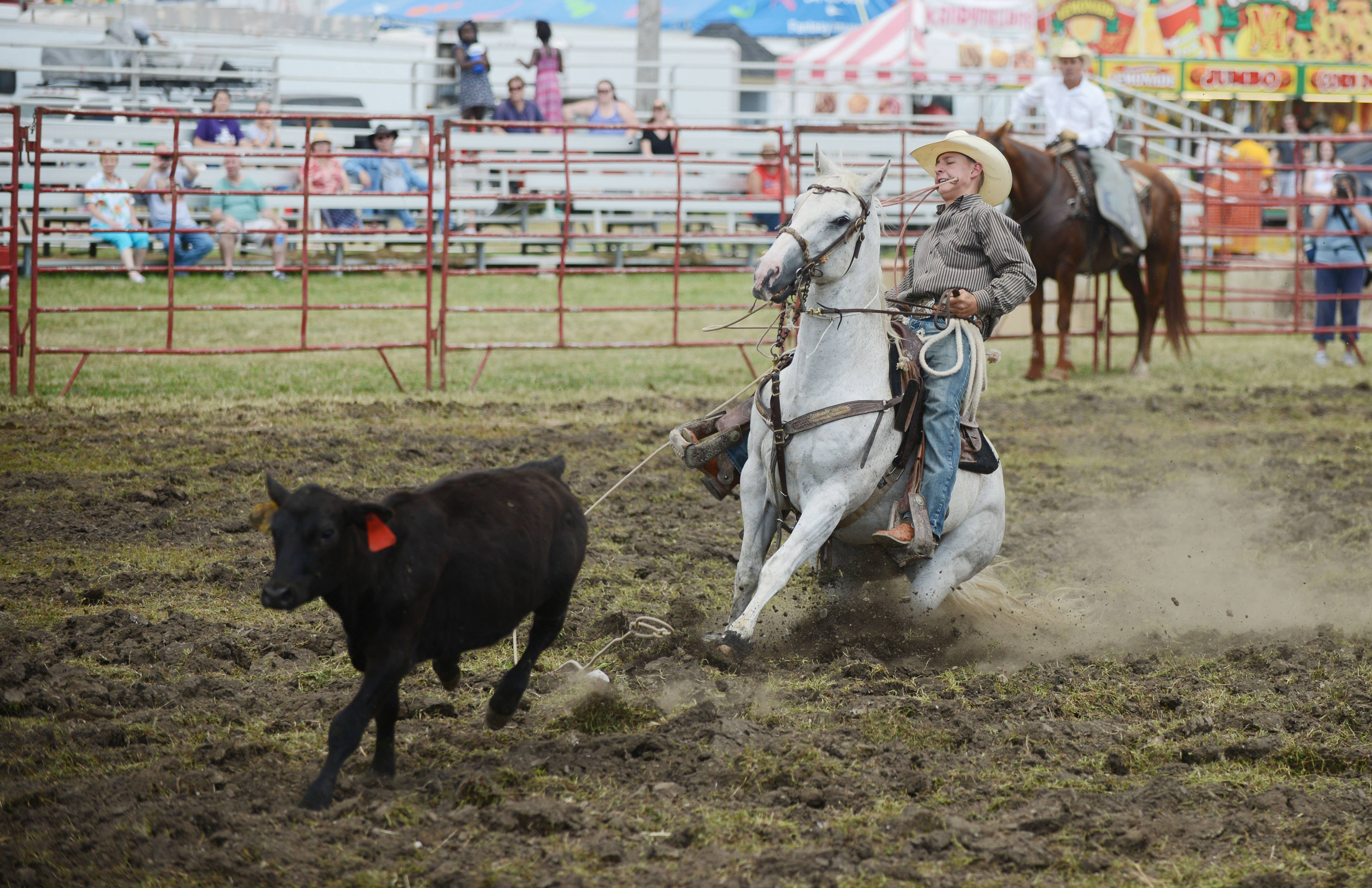 A cowboy demonstrates roping Saturday at the DuPage County Fair in Wheaton.