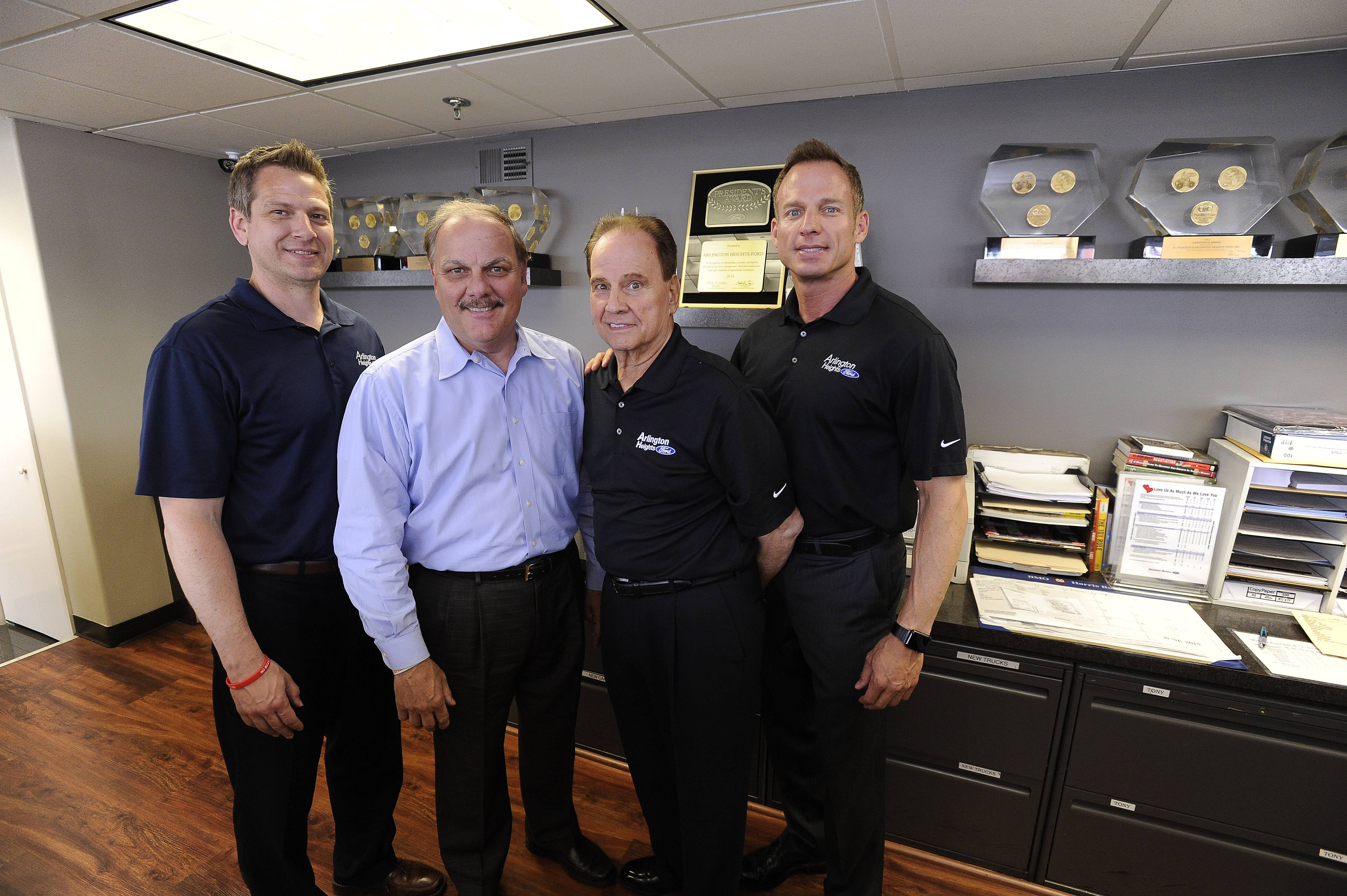 The Guido family owns Arlington Heights Ford. From left, Dave Tomczyk, controller; dealer operator and owners Tony Guido and his brother, John Guido Sr.; and John Guido Jr., general sales manager.