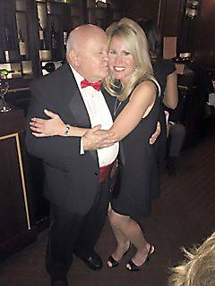 "Former Mayor George Pradel kisses the city's ""happy face,"" Dolly McCarthy. Pradel ordered a ""Dolly McCarthy Day"" in Naperville last year to honor the emcee and radio host for her good work."