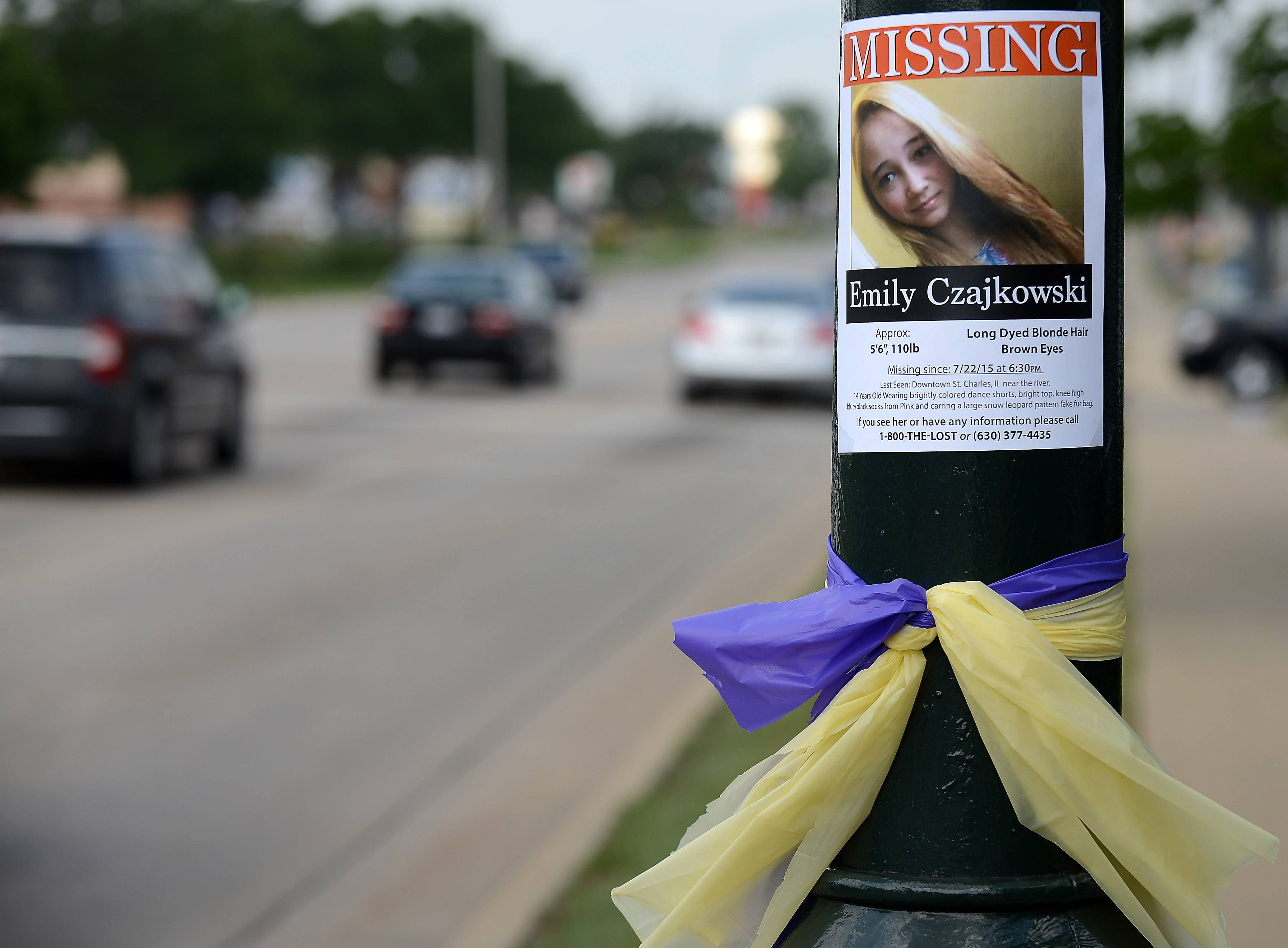 Posters about missing teen Emily Czajkowski, 14, of Campton Hills dot many lampposts, trees and utility poles Monday morning in St. Charles. She went missing Wednesday after being dropped off for a dance class in St. Charles. Ribbons in what are said to be her favorite colors are common along Route 64.