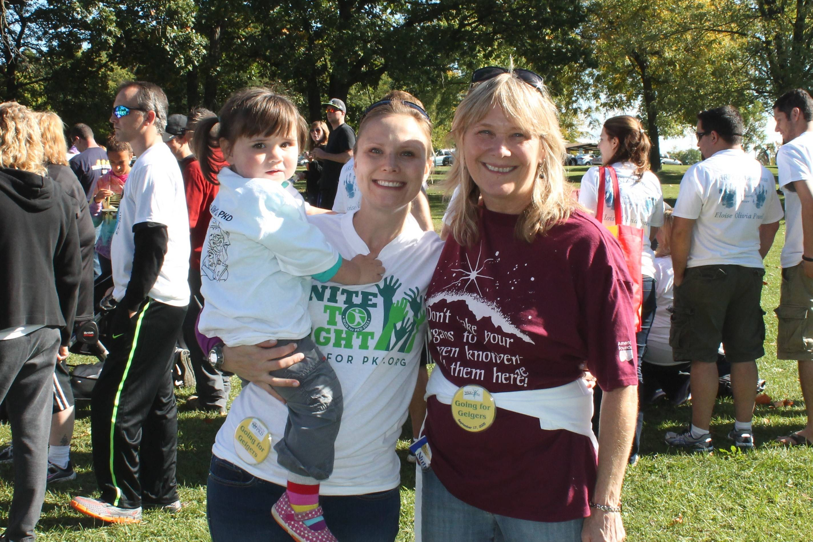 Amy Manelli holds her daughter Quinn while with her mom, Laurie Geiger, at the 2013 Chicago Walk for PKD.