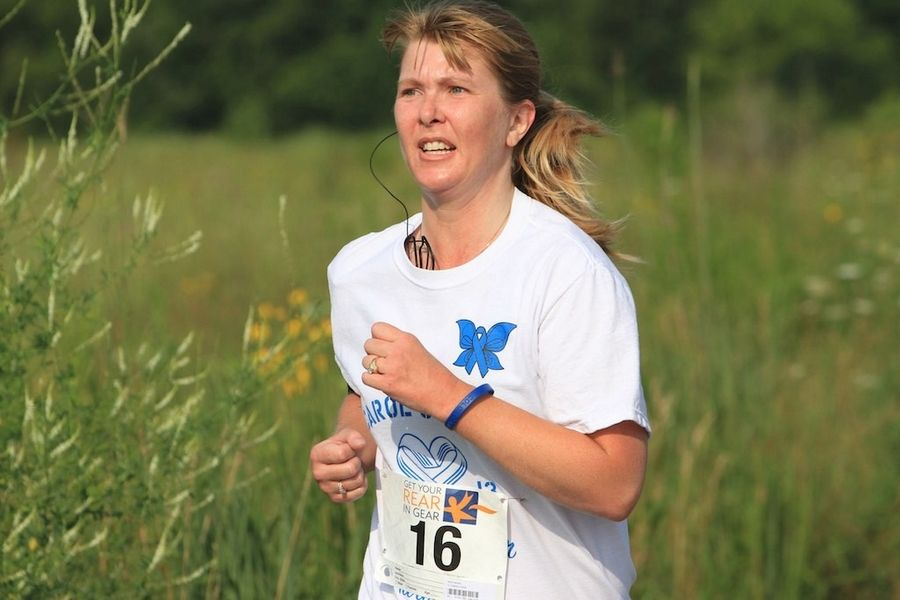 Barb Hannan of North Aurora runs in honor of her mother, Carol Voeks, who passed away from colon cancer.