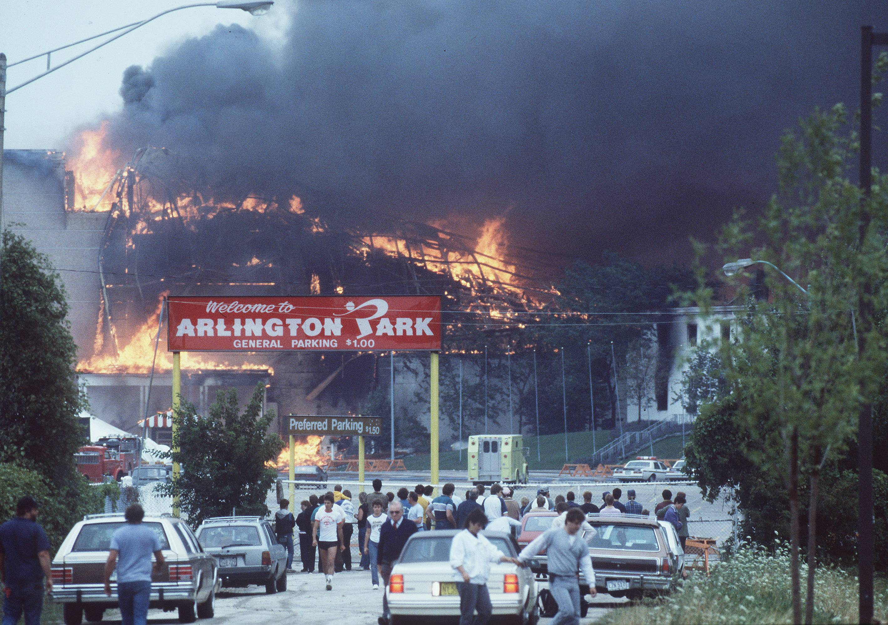 People come to watch as the Arlington Park fire rages out of control on July 31, 1985.
