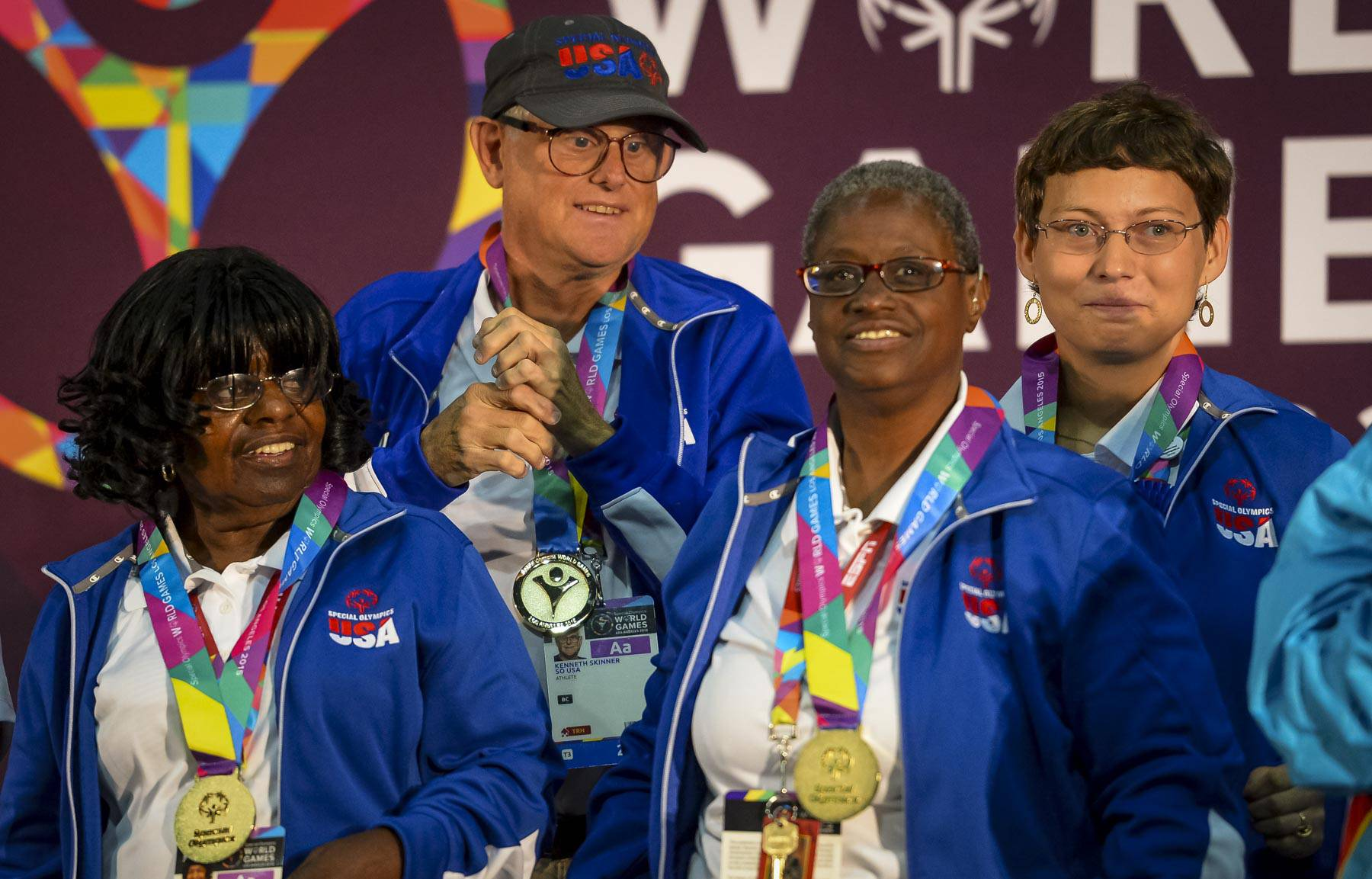 United States' bocce team players from left to right, Mary Davis, Kenneth Skinner, Sheryl Fairbanks and Nicole Landoskey get their gold medal in team play during the 2015 Special Olympics World Games, Monday, July 27, 2015, in Los Angeles.