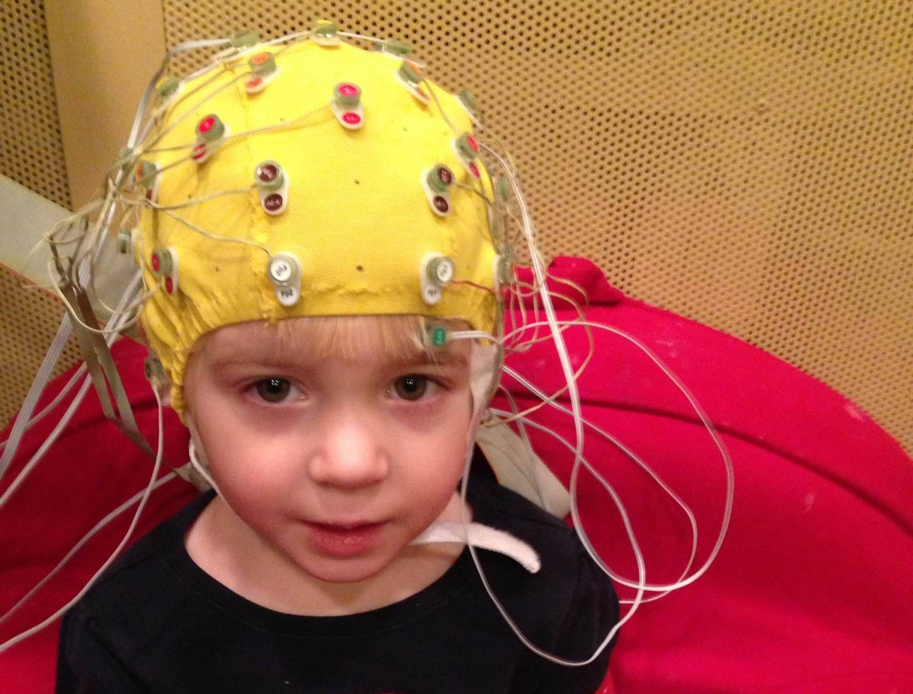 This photo provided by the Auditory Neuroscience Lab, Northwestern University, shows scalp electrodes to pick up how children's brains react to sounds such as speech in a noisy background. New research suggests it may be possible to predict which preschoolers will struggle to read, and it has to do with how they decipher speech when it's noisy.