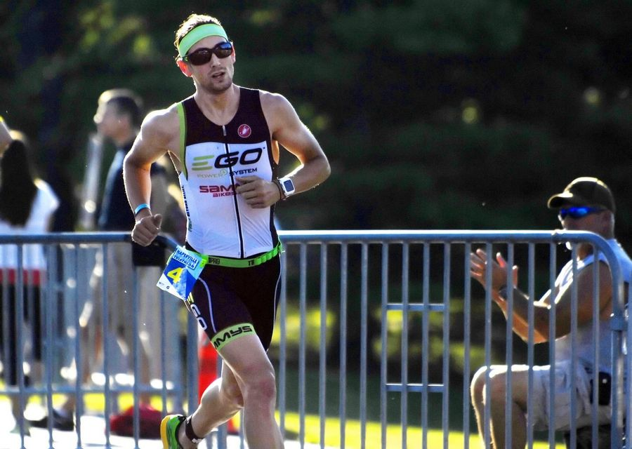 Alex Arman, 27, of St. Charles starts the run portion Sunday at the Naperville Sprint Triathlon. Arman won the event with a time of 56 minutes, 23 seconds.