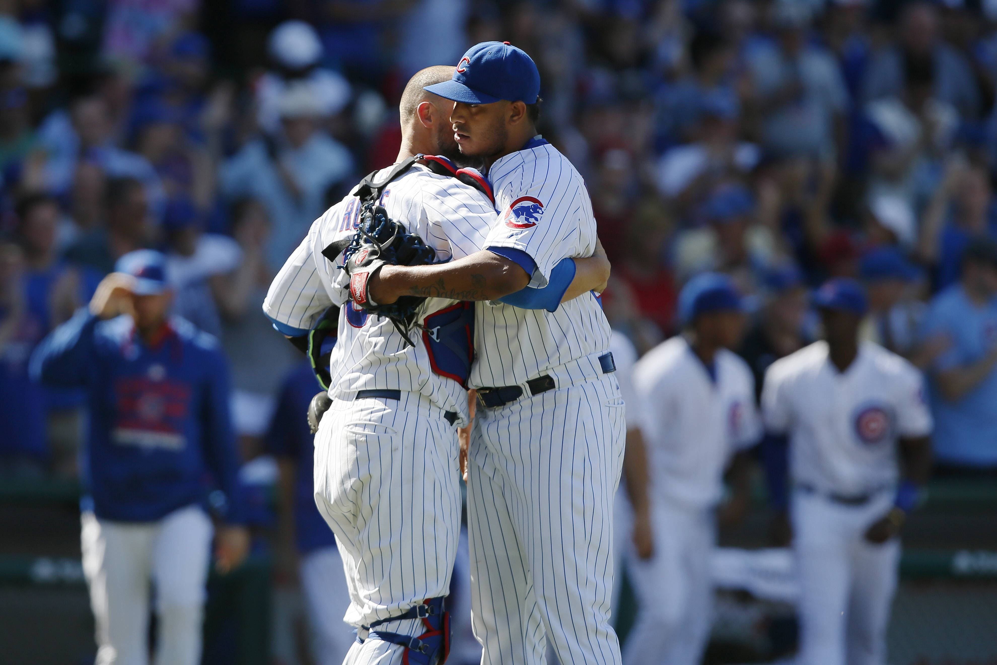 Chicago Cubs relief pitcher Hector Rondon, right, celebrates with catcher David Ross after they defeated the Colorado Rockies in a baseball game in Chicago, Wednesday, July 29, 2015. The Cubs won 3-2.