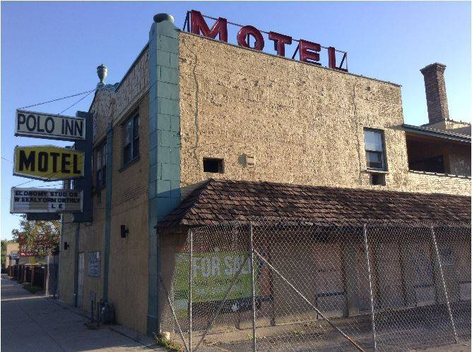 The Polo Inn motel, which Des Plaines officials want to demolish, remains boarded up and fenced in, while litigation over the building's future could last years.