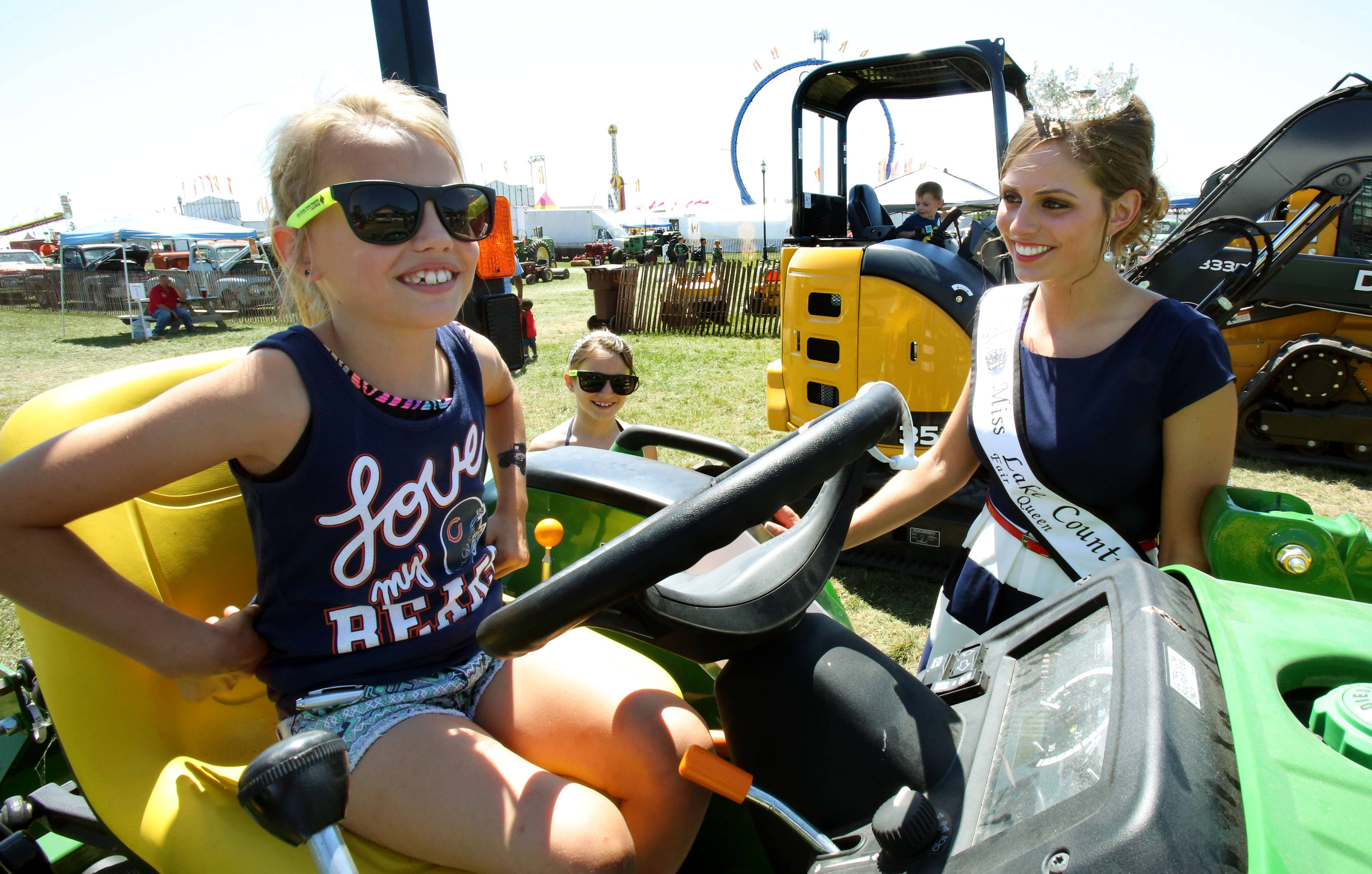 Miss Lake County Fair 2015 Bethani Jacobsen, right, Wauconda talks with 8-year-old Holli Brown of Round Lake Beach at the Lake County Fair in Grayslake Thursday.