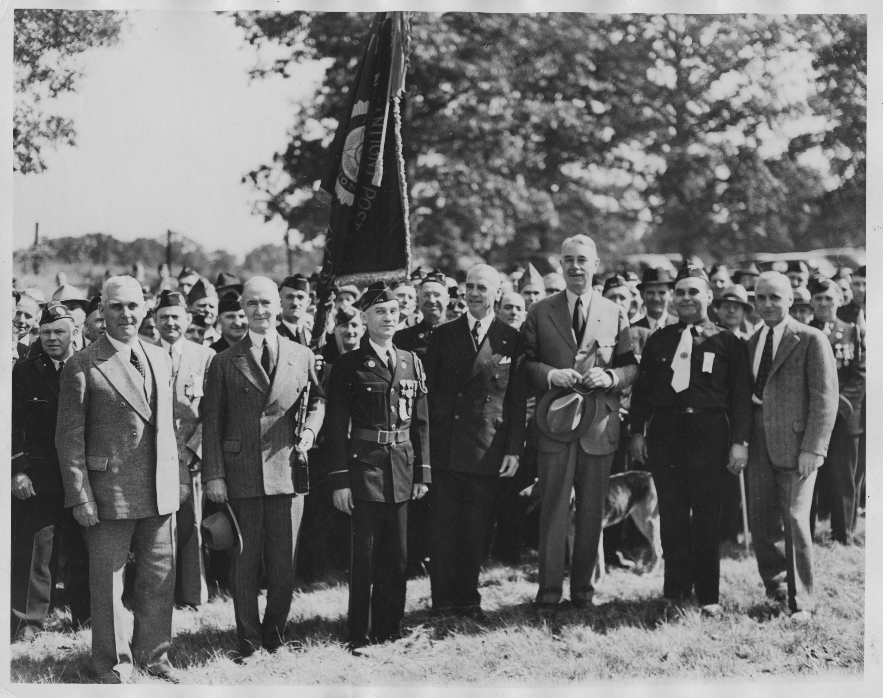 Colonel McCormick, third from right, frequently invited veterans to Cantigny for reunions. Guests would ride the train to Winfield and then march two miles south to the Wheaton estate.