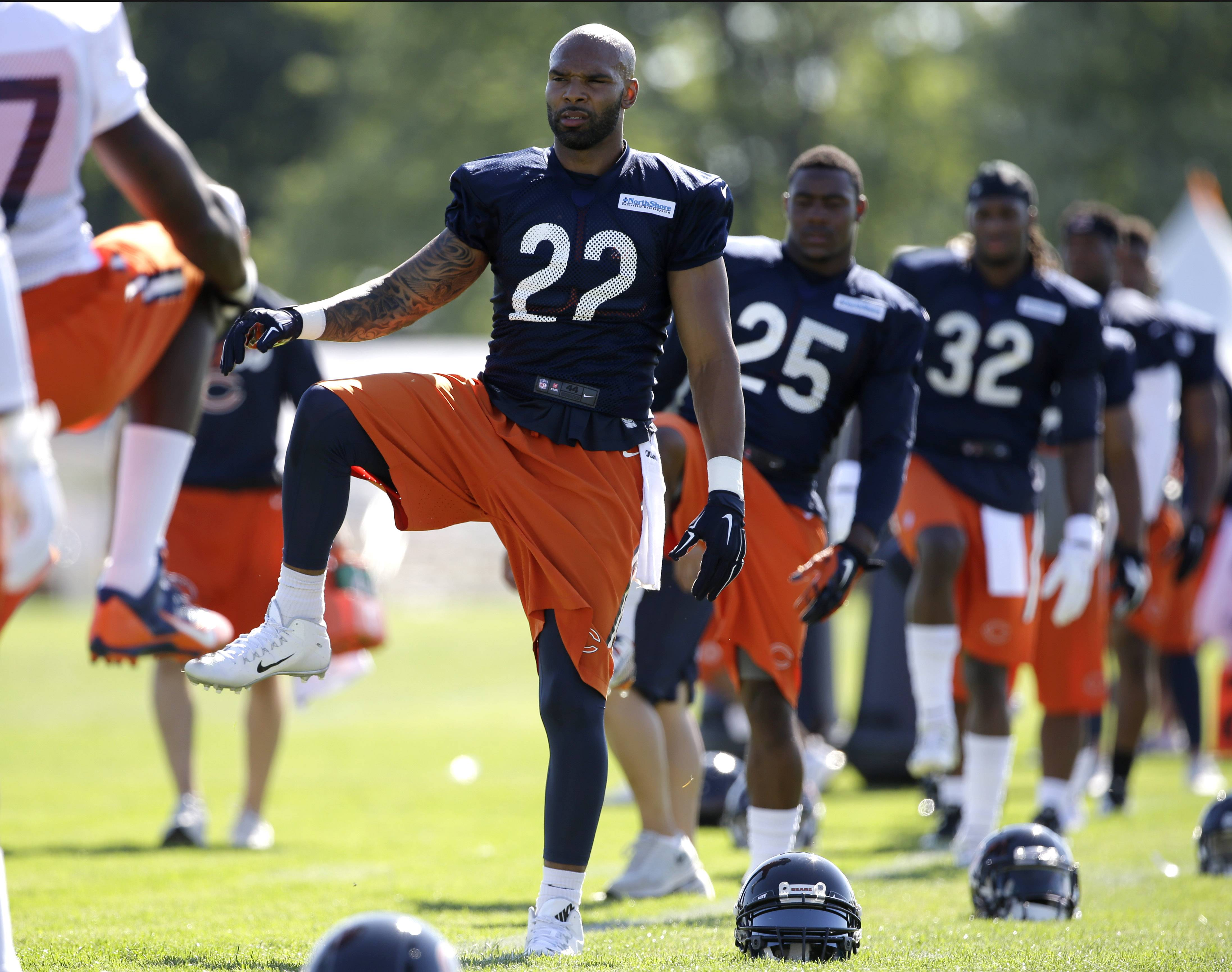 Bears running back Matte Forte stretches with teammates as practice for a new season gets underway Thursday at training camp in Bourbonnais.