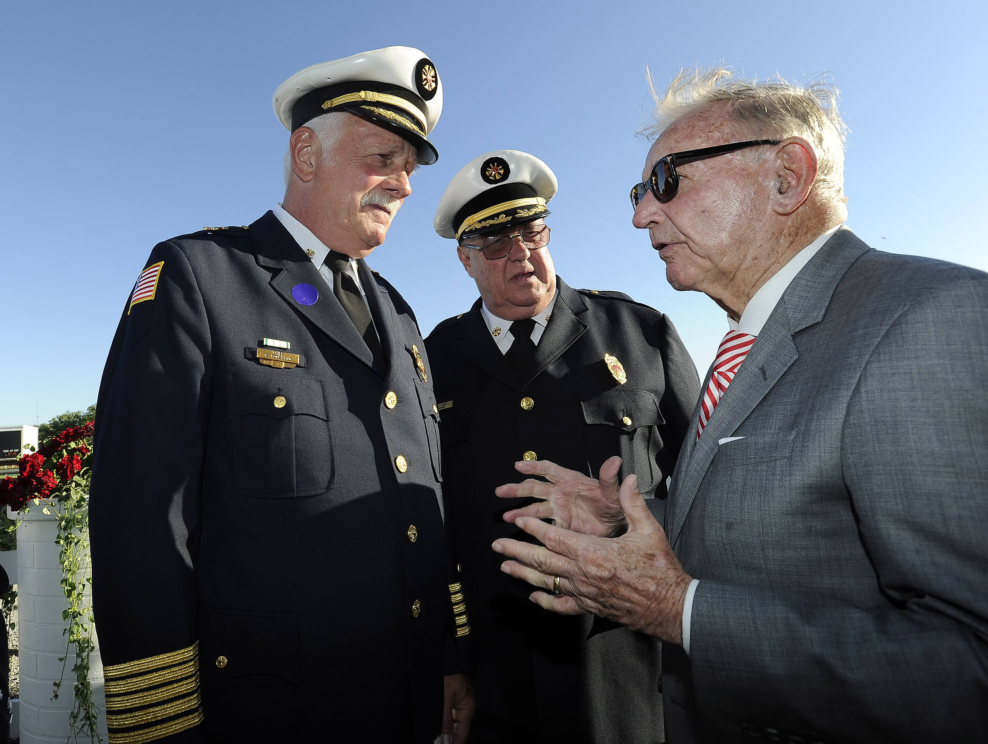 Arlington Park owner Dick Duchossois talks with former Arlington Heights Fire Chief Bruce Rodewald, left, and Assistant Emergency Management Coordinator Charles Kramer on Friday. Duchossois thanked the first responders for their gallant efforts battling the fire at the track 30 years.