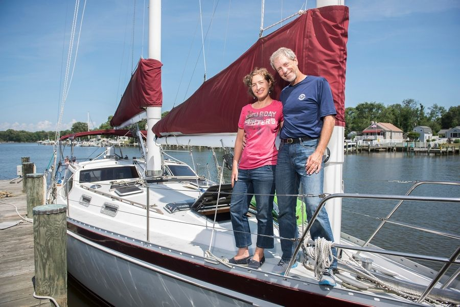 "Renee and Greg Cantori of Pasadena, Maryland, own a light-filled 238-square-foot house with room for a queen-size bed in the loft. After they retire, they hope to live a ""surf 'n' turf"" lifestyle, splitting time between their boat and the tiny house."