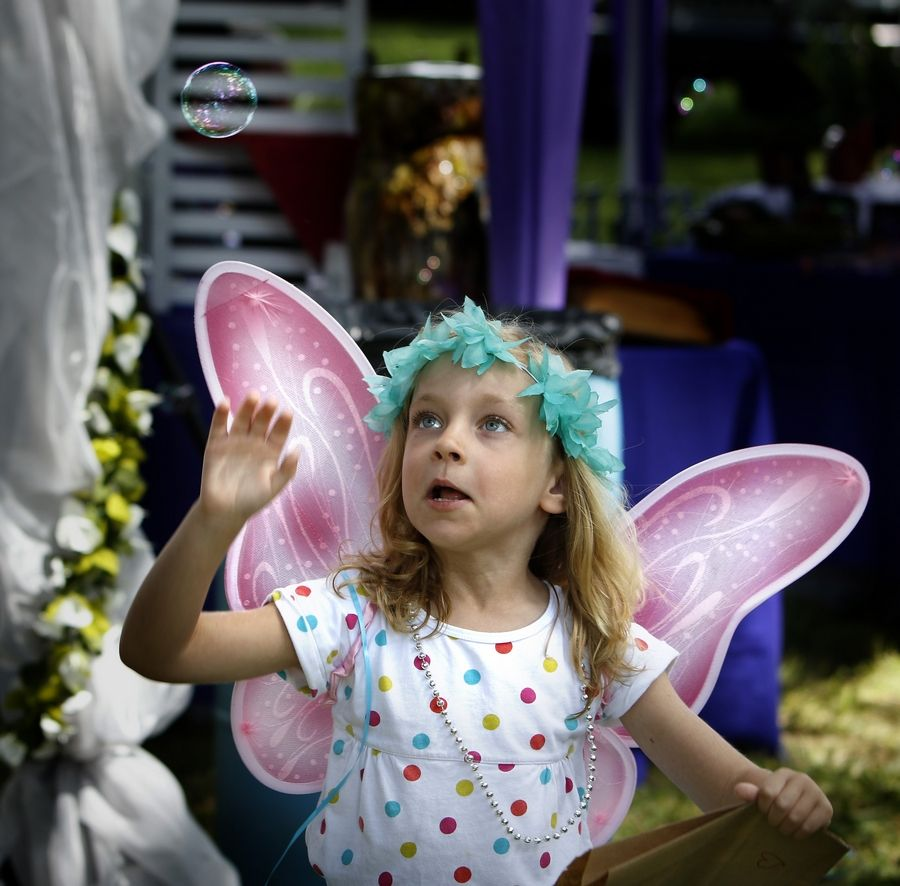 Five-year-old faerie Sarah Buckner of Algonquin chases bubbles Saturday during the 11th annual World of Faeries Festival at Vasa Park in South Elgin.
