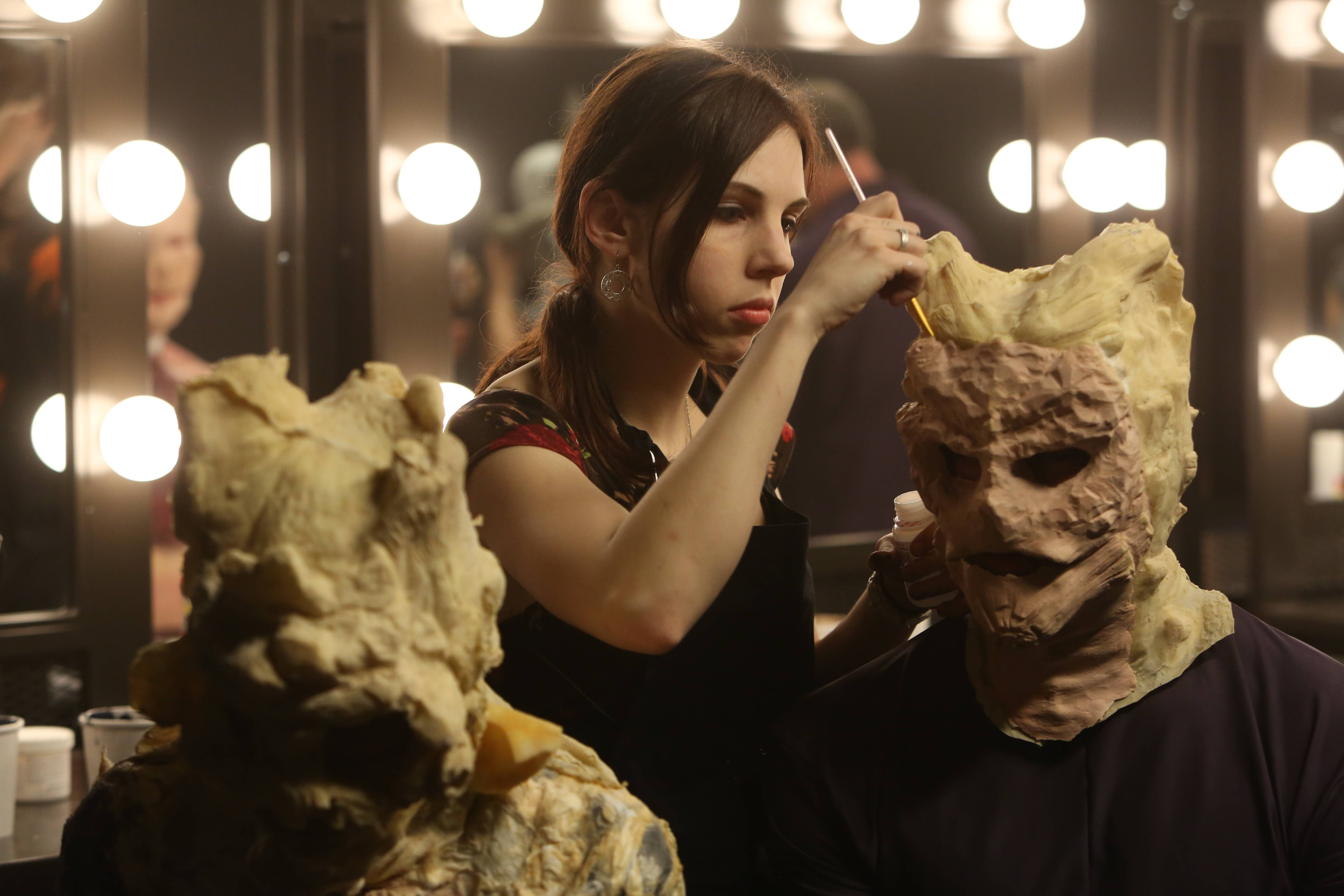 Stevie Calabrese, of Grayslake, applies makeup to a creature she created for Face Off, a reality show on Syfy.