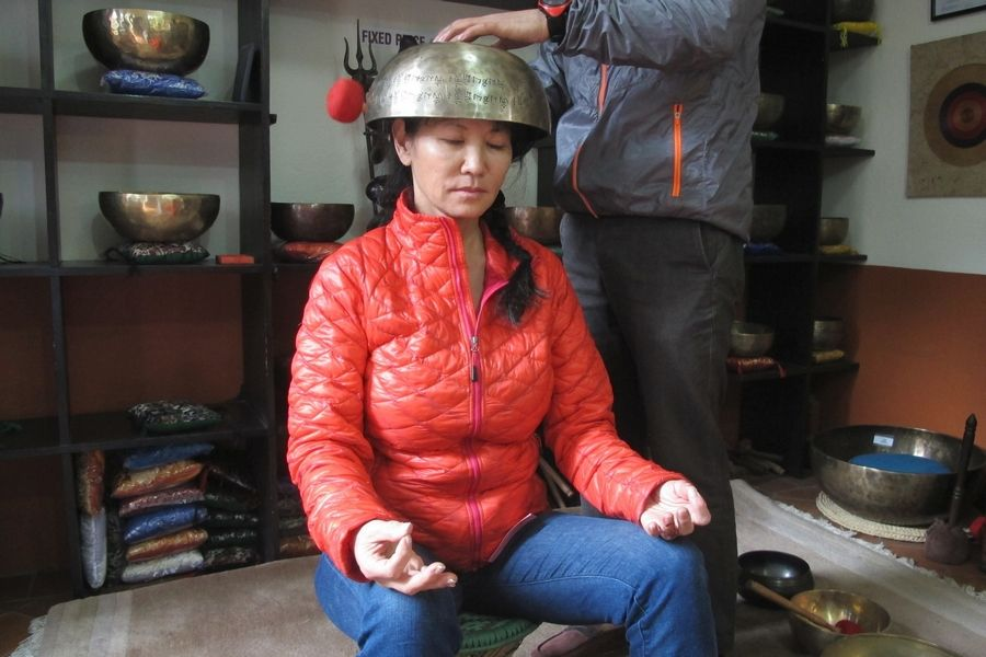 Mia Scheid, owner of Palatine-based Fitness Arts, experiencing a singing bowl made by local monks in Tibet in March.