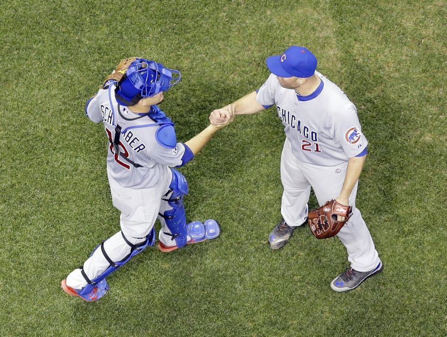 Cubs reliever Tommy Hunter is congratulated by catcher Kyle Schwarber after getting his first save as a Cub on Saturday against Milwaukee. Hunter and starter Dan Haren will help stabilize the rotation and bullpen, says Connor McKnight.