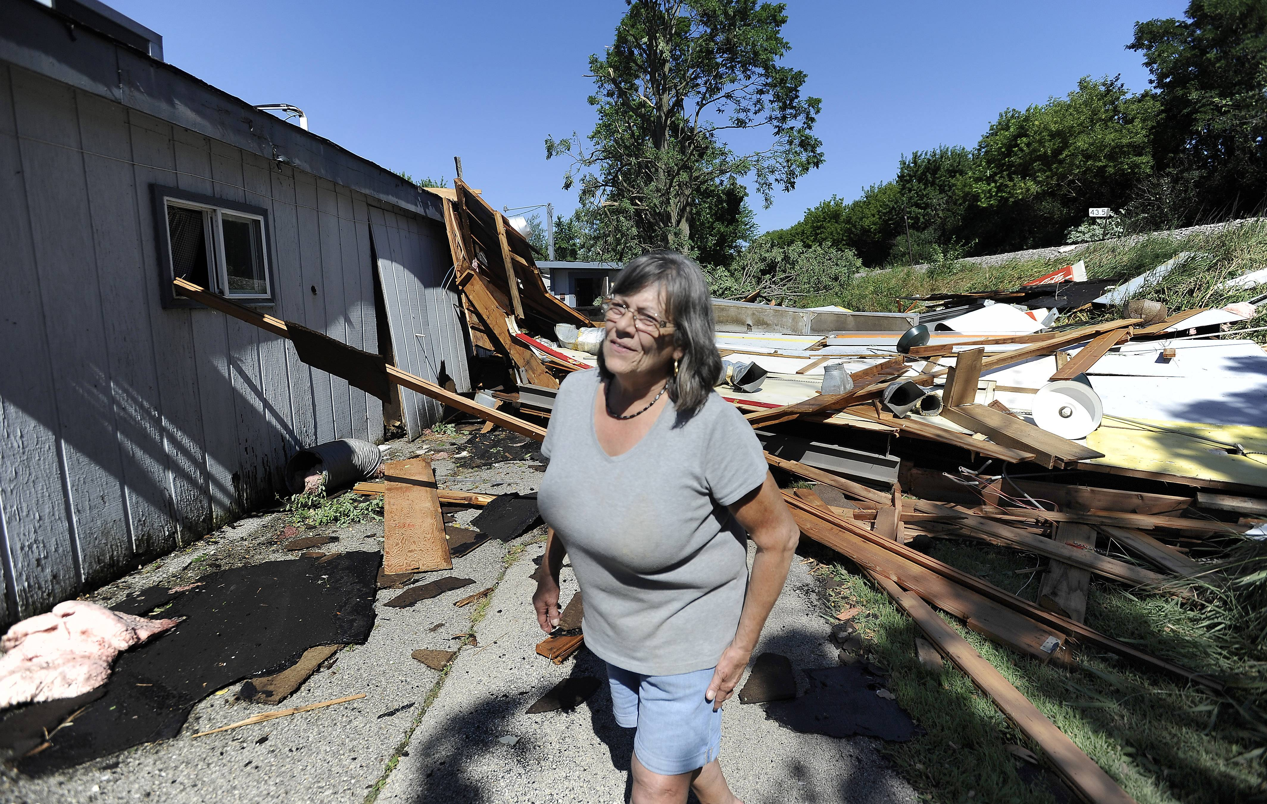 Owner Jean McCue of the Pizza Place in Round Lake Park waits for her insurance person as she looks over the damage to her place after a tornado came through about 8:30 p.m. on Sunday.