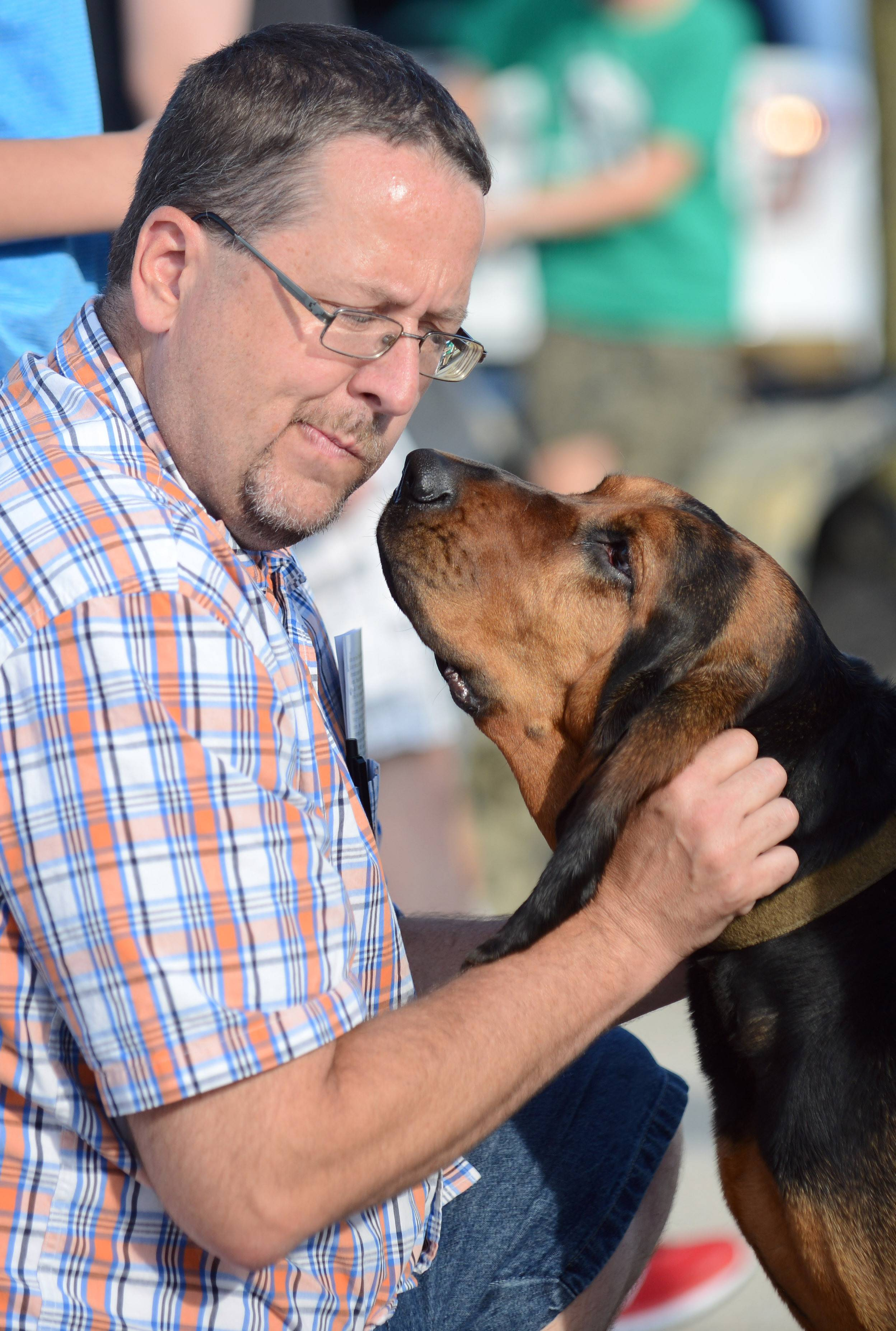 Kane County Sheriff K-9 bloodhound, Erin, gives John Burkhalter of Aurora a good sniff while meeting residents at the Kane County Sheriff's National Night Out event in St. Charles Tuesday.