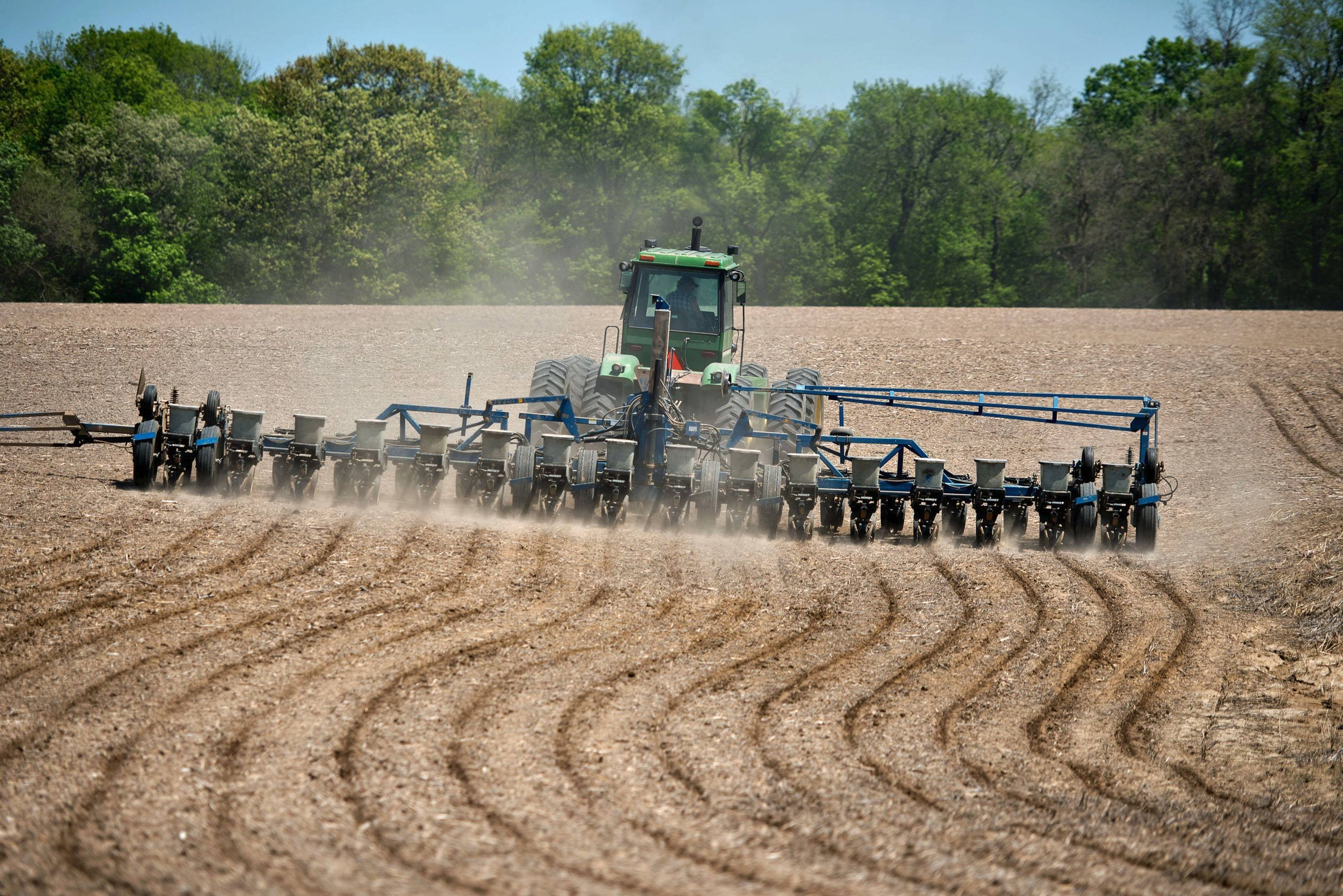 In defense of corn, our most indispensable crop. Corn is planted in a field in the Midwest. Illustrates FOOD-CORN-CROP (category d), by Tamar Haspel, special to The Washington Post. Moved Wednesday, July 15, 2015. (MUST CREDIT: Bloomberg News photo by Daniel Acker)