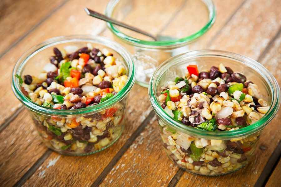To determine once and for all the best way to cook corn, the author got down to the basics. Corn and fire, put to the test. Here, Smoked Corn and Black Bean Salad.