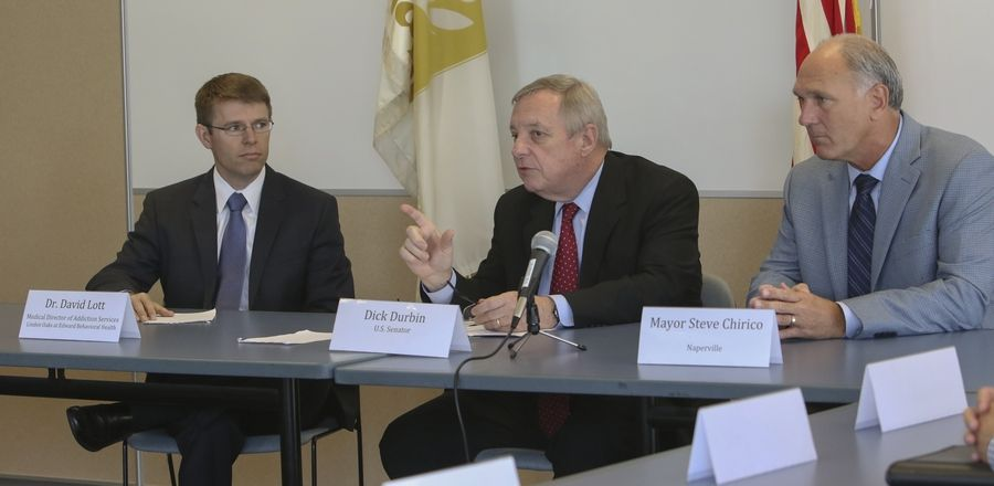 U.S. Sen. Dick Durbin, center, leads a roundtable discussion about the surge of lethal drug overdoses and heroin use across the nation. On the left is Dr. David Lott, medical director of addiction services for Linden Oaks at Edward Behavioral Health, and on the right is Naperville Mayor Steve Chirico.