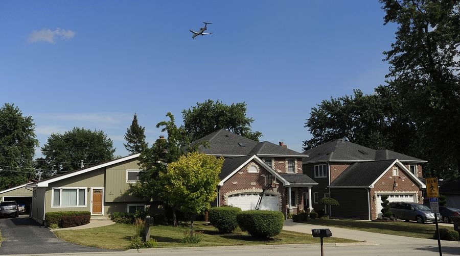 An inbound plane flies over Wood Dale, one of many suburbs suffering jet noise near O'Hare.
