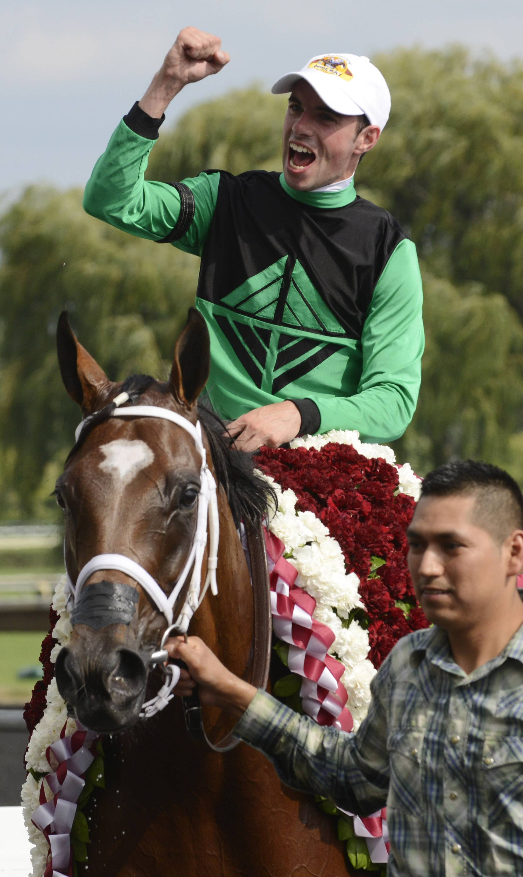 Jockey Florent Geroux celebrates after winning the American St. Leger aboard The Pizza Man during the International Festival of Racing at Arlington International Racecourse in August 2014. The Pizza Man's owners are hoping the horse can become the first Illinois-bred to capture the Million.