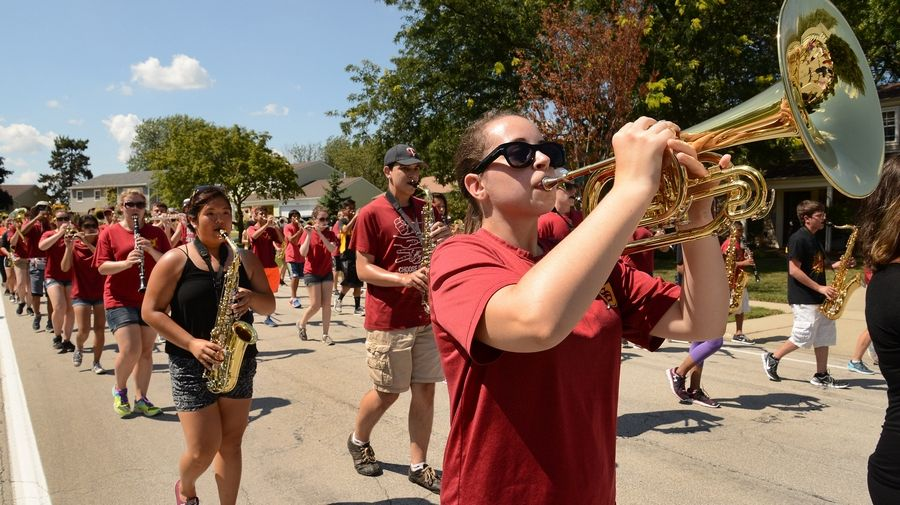 Leah Routson plays the mellophone as the Schaumburg High School Band parades around the neighborhood getting ready for Septemberfest.