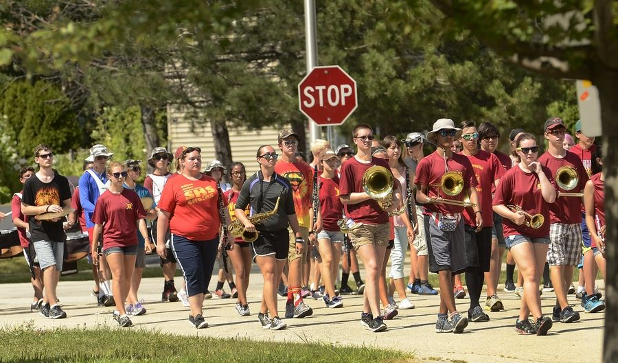 The Schaumburg High School Band parades around the neighborhood getting ready for Septemberfest.