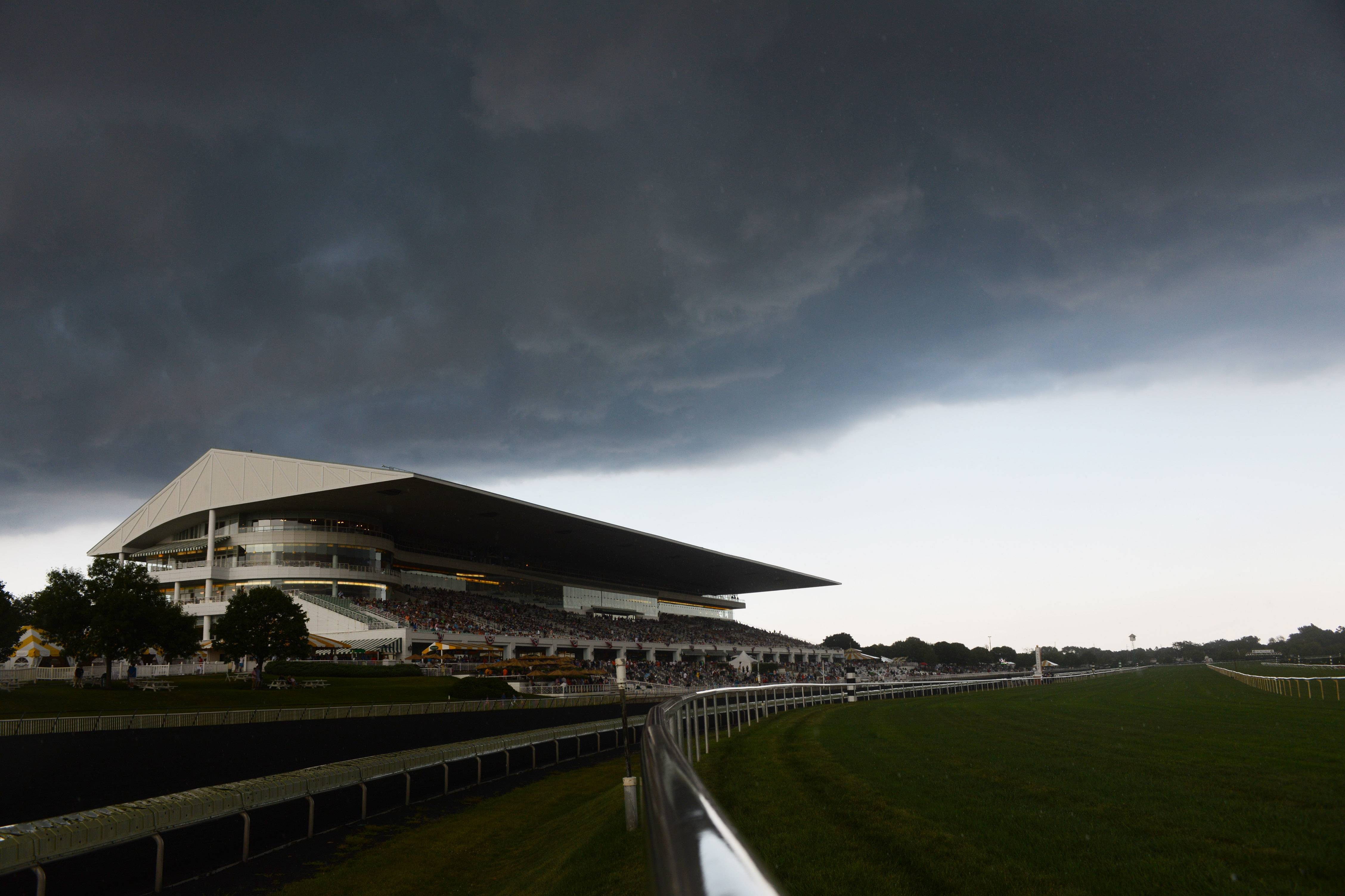 A storm cloud moves over the grandstand before a heavy rain shower Saturday during Arlington International Festival of Racing.