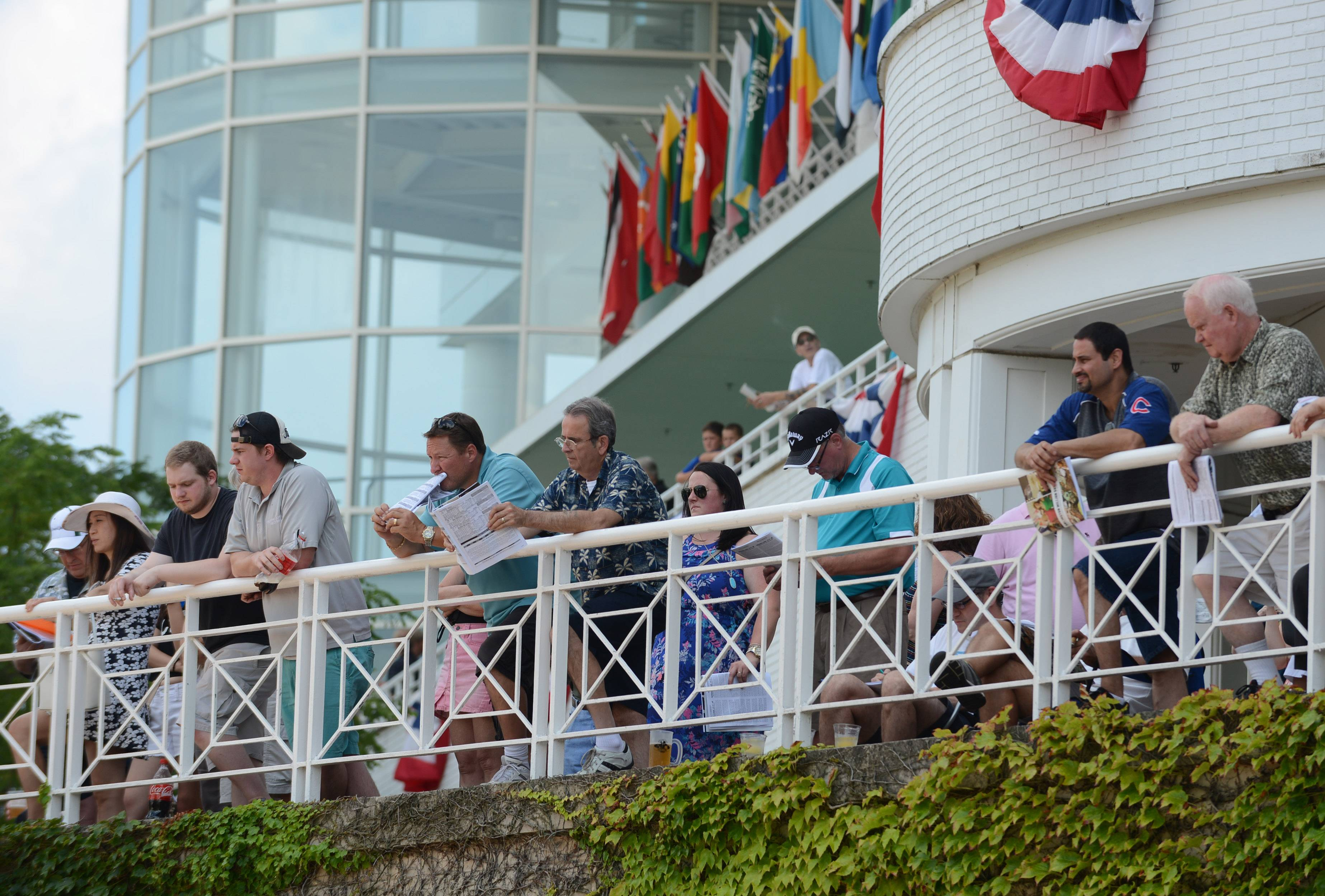 Racing fans view the paddock from above Saturday during Arlington International Festival of Racing.